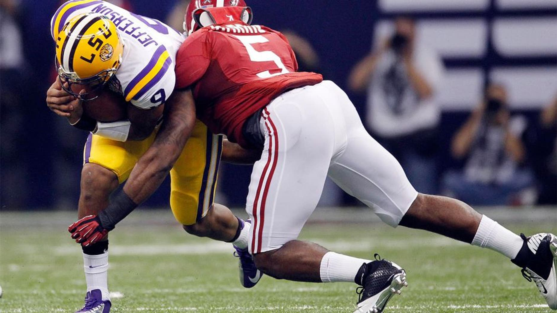 Jan 9, 2012; New Orleans, LA, USA; LSU Tigers quarterback Jordan Jefferson (9) is tackled by Alabama Crimson Tide linebacker Jerrell Harris (5) during the first half of the 2012 BCS National Championship game at the Mercedes-Benz Superdome. Mandatory Credit: Derick E. Hingle-USA TODAY Sports