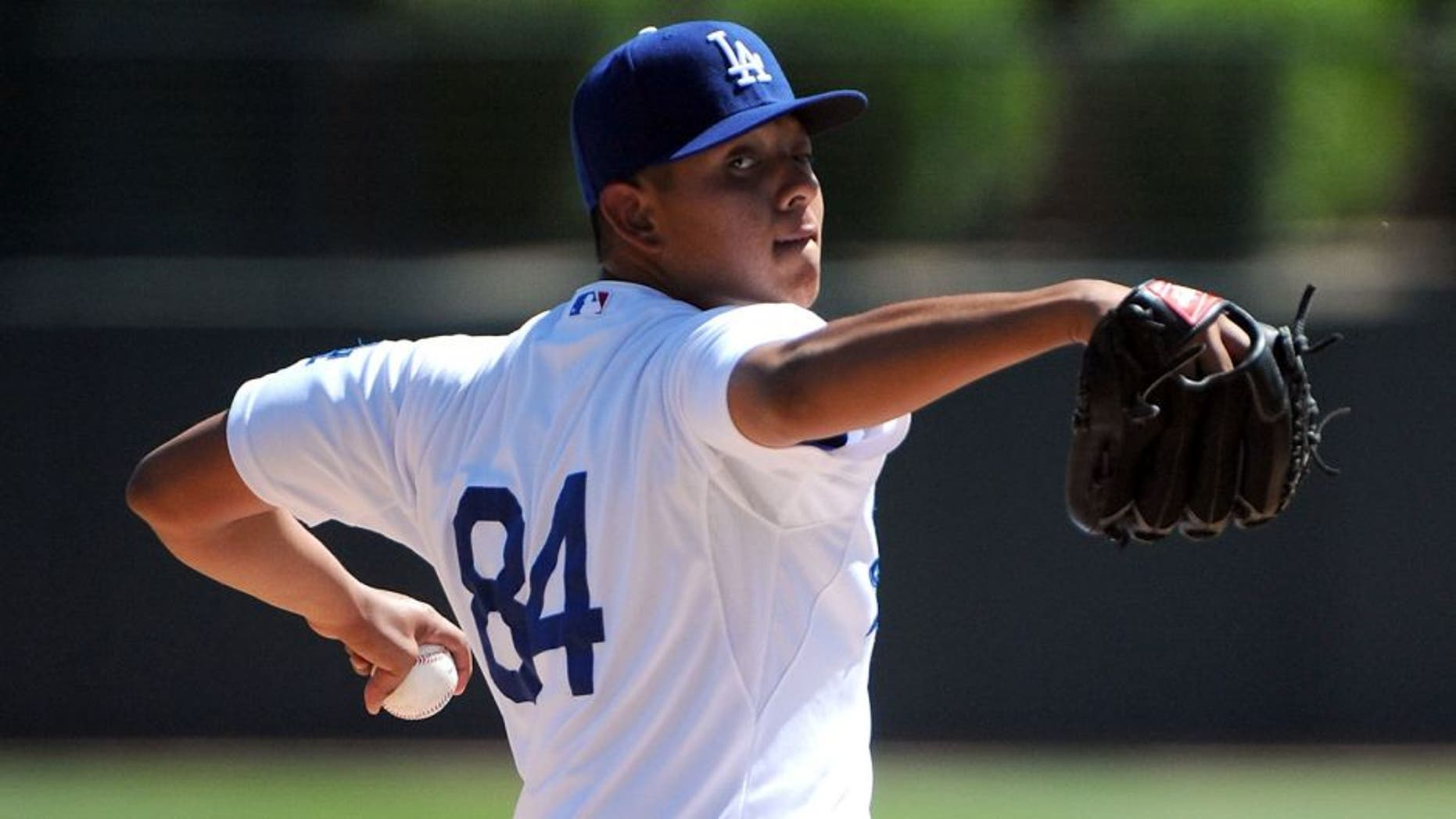 GLENDALE, AZ - MARCH 15: Julio Urias #84 of the Los Angeles Dodgers pitches against the San Diego Padres at Camelback Ranch on March 15, 2014 in Glendale, Arizona. (Photo by Lisa Blumenfeld/Getty Images)