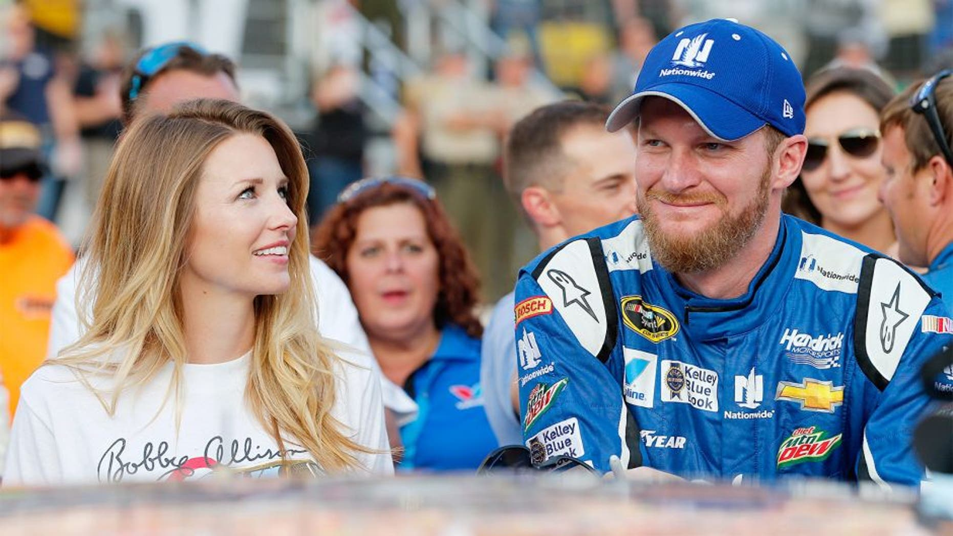 BRISTOL, TN - AUGUST 22: Dale Earnhardt Jr., driver of the #88 Nationwide Chevrolet, stands on the grid with his fiance, Amy Reimann, prior to the NASCAR Sprint Cup Series IRWIN Tools Night Race at Bristol Motor Speedway on August 22, 2015 in Bristol, Tennessee. (Photo by Brian Lawdermilk/Getty Images)