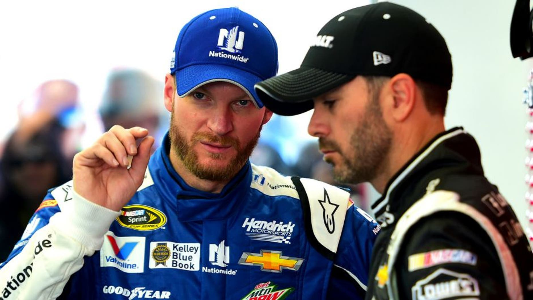 LAS VEGAS, NV - MARCH 07: Dale Earnhardt Jr., driver of the #88 Nationwide Chevrolet, speaks with Jimmie Johnson, driver of the #48 Kobalt Tools Chevrolet, in the garage during qualifying for the NASCAR XFINITY Series Boyd Gaming 300 at Las Vegas Motor Speedway on March 7, 2015 in Las Vegas, Nevada. (Photo by Robert Laberge/Getty Images)