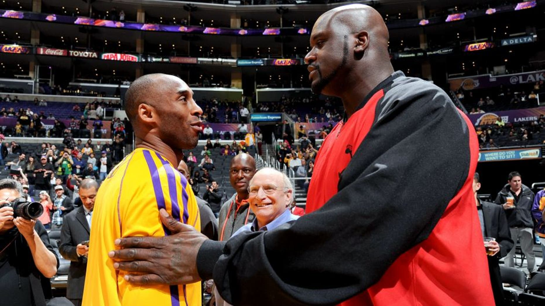 LOS ANGELES, CA - FEBRUARY 12: Former NBA player Shaquille O'Neal greets former teammate Kobe Bryant #24 of the Los Angeles Lakers before a game between the Lakers and the Phoenix Suns at Staples Center on February 12, 2013 in Los Angeles, California. NOTE TO USER: User expressly acknowledges and agrees that, by downloading and/or using this Photograph, user is consenting to the terms and conditions of the Getty Images License Agreement. Mandatory Copyright Notice: Copyright 2013 NBAE (Photo by Andrew D. Bernstein/NBAE via Getty Images)