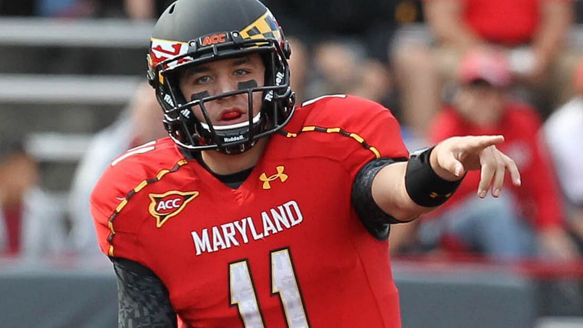 October 6, 2012; College Park, MD, USA; Maryland Terrapins quarterback Perry Hills (11) directs the offense against the Wake Forest Demon Deacons at Byrd Stadium. Mandatory Credit: Mitch Stringer-USA TODAY Sports