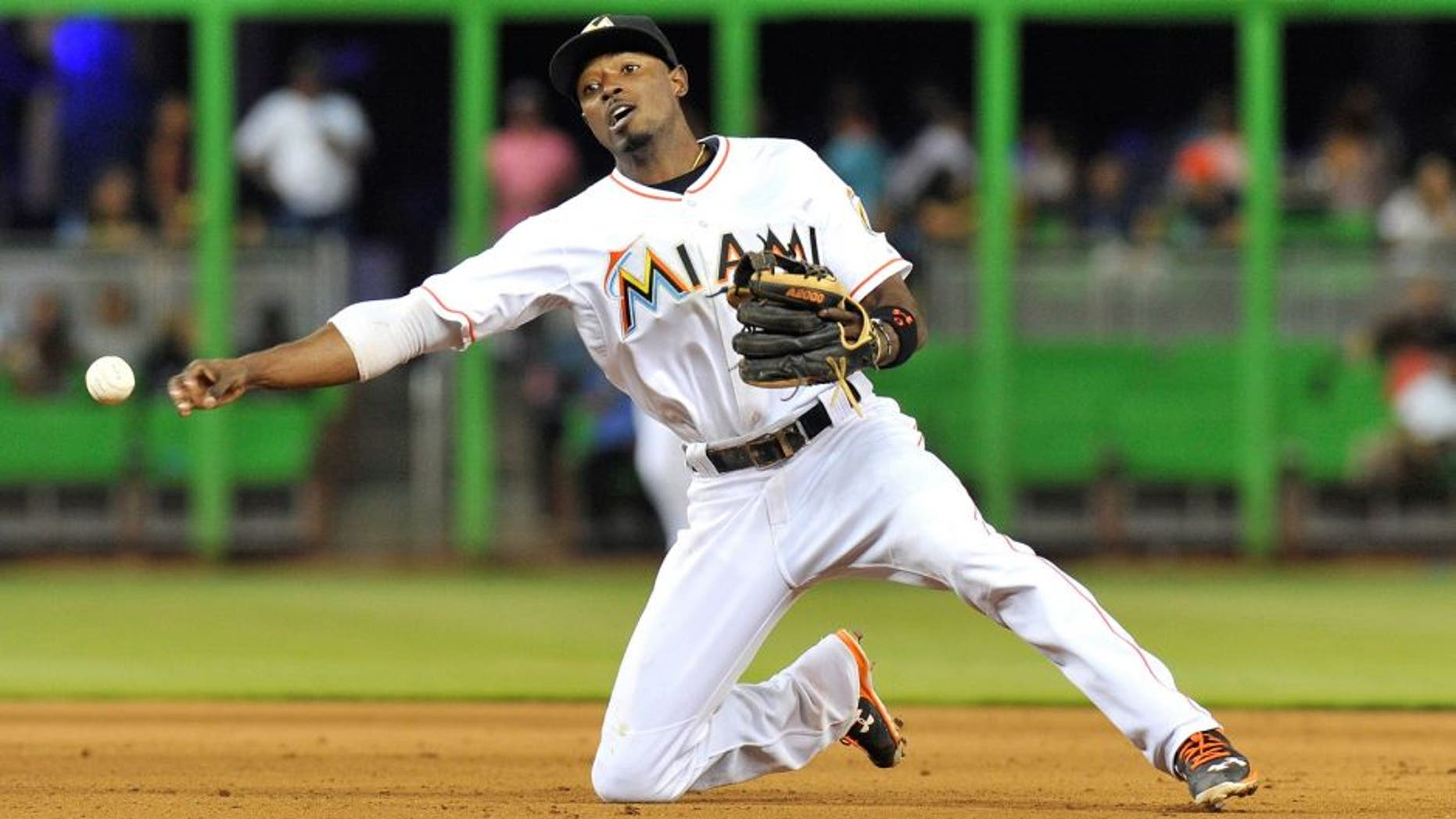 Aug 24, 2015; Miami, FL, USA; Miami Marlins second baseman Dee Gordon (9) throws over to first base during the eighth inning against the Pittsburgh Pirates at Marlins Park. Mandatory Credit: Steve Mitchell-USA TODAY Sports