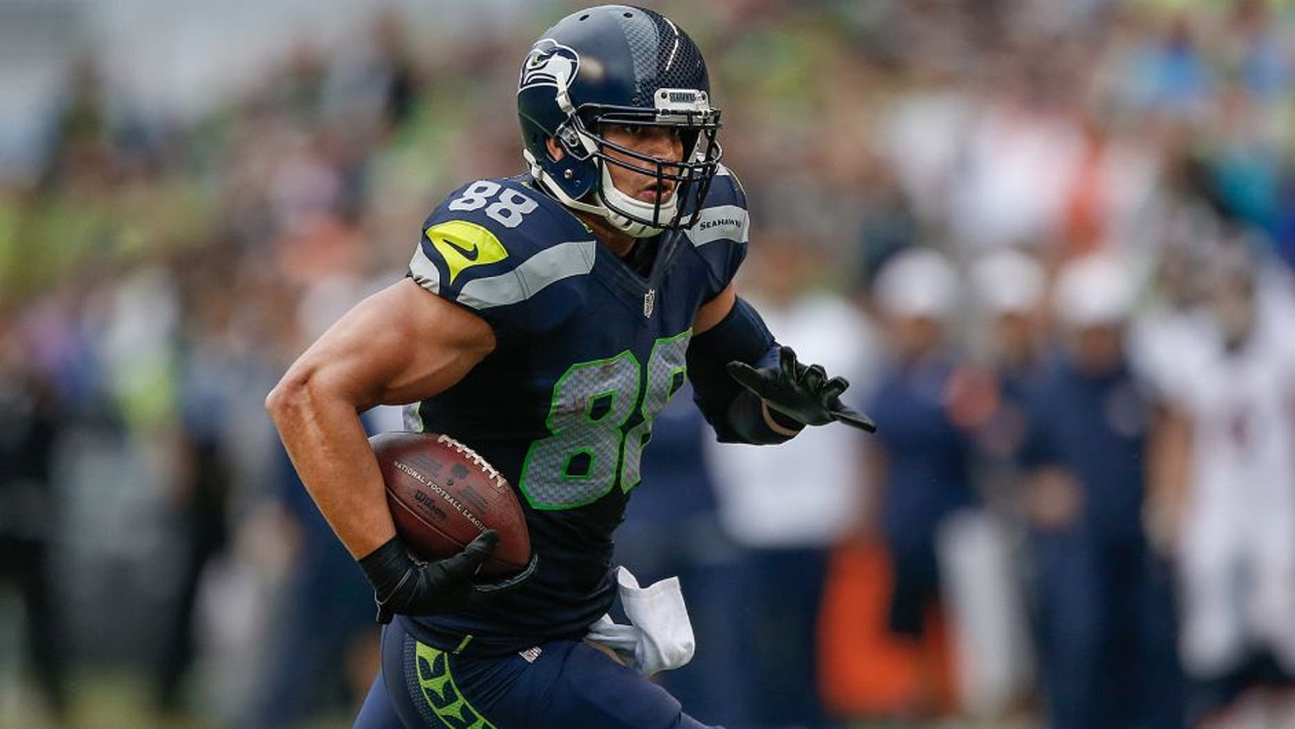 SEATTLE, WA - AUGUST 14: Tight end Jimmy Graham #88 of the Seattle Seahawks rushes against the Denver Broncos at CenturyLink Field on August 14, 2015 in Seattle, Washington. (Photo by Otto Greule Jr/Getty Images)