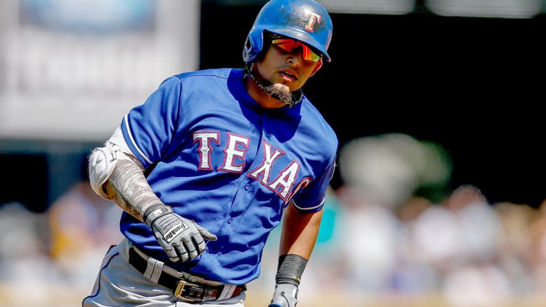 SEATTLE, WA - AUGUST 27: Rougned Odor #12 of the Texas Rangers rounds the bases after hitting a grand slam in the third inning against the Seattle Mariners at Safeco Field on August 27, 2014 in Seattle, Washington. The Rangers defeated the Mariners 12-4. (Photo by Otto Greule Jr/Getty Images)