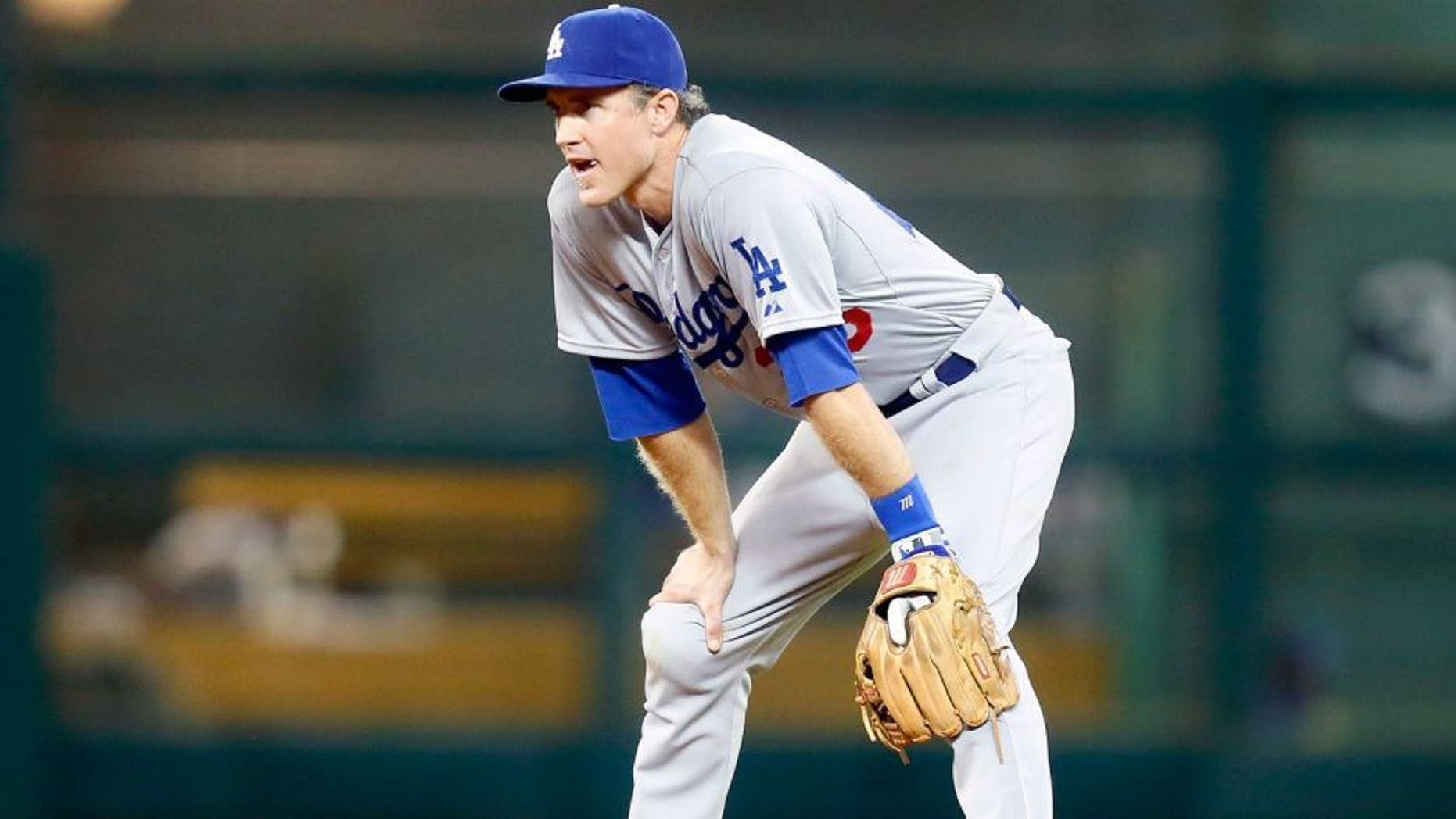 HOUSTON, TX - AUGUST 22: Chase Utley #26 of the Los Angeles Dodgers during game action against the Houston Astros at Minute Maid Park on August 22, 2015 in Houston, Texas. (Photo by Bob Levey/Getty Images)