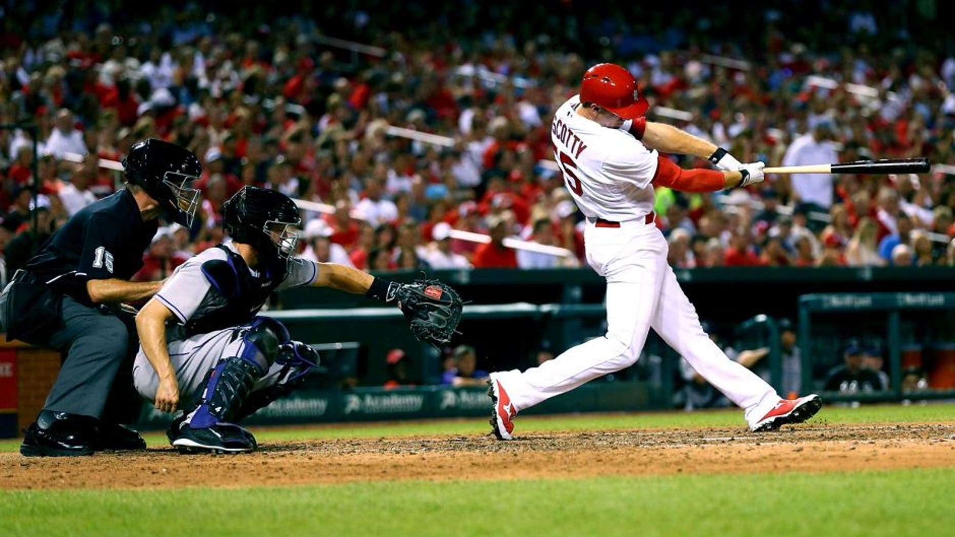 ST. LOUIS, MO - JULY 31: Stephen Piscotty #55 of the St. Louis Cardinals hits a two-RBI double against the Colorado Rockies in the sixth inning at Busch Stadium on July 31, 2015 in St. Louis, Missouri. (Photo by Dilip Vishwanat/Getty Images)