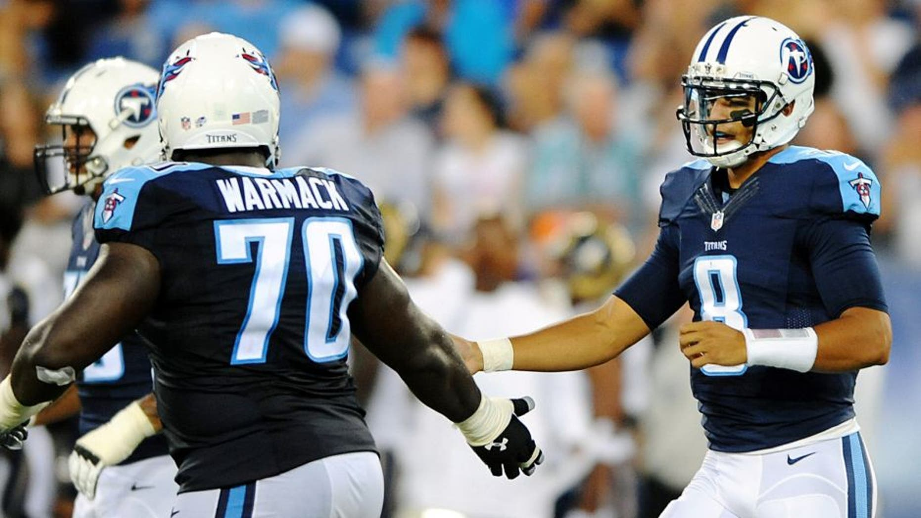 Aug 23, 2015; Nashville, TN, USA; Tennessee Titans quarterback Marcus Mariota (8) is congratulated by guard Chance Warmack (70) after completing a first down during the first half against the St. Louis Rams at Nissan Stadium. Mandatory Credit: Christopher Hanewinckel-USA TODAY Sports