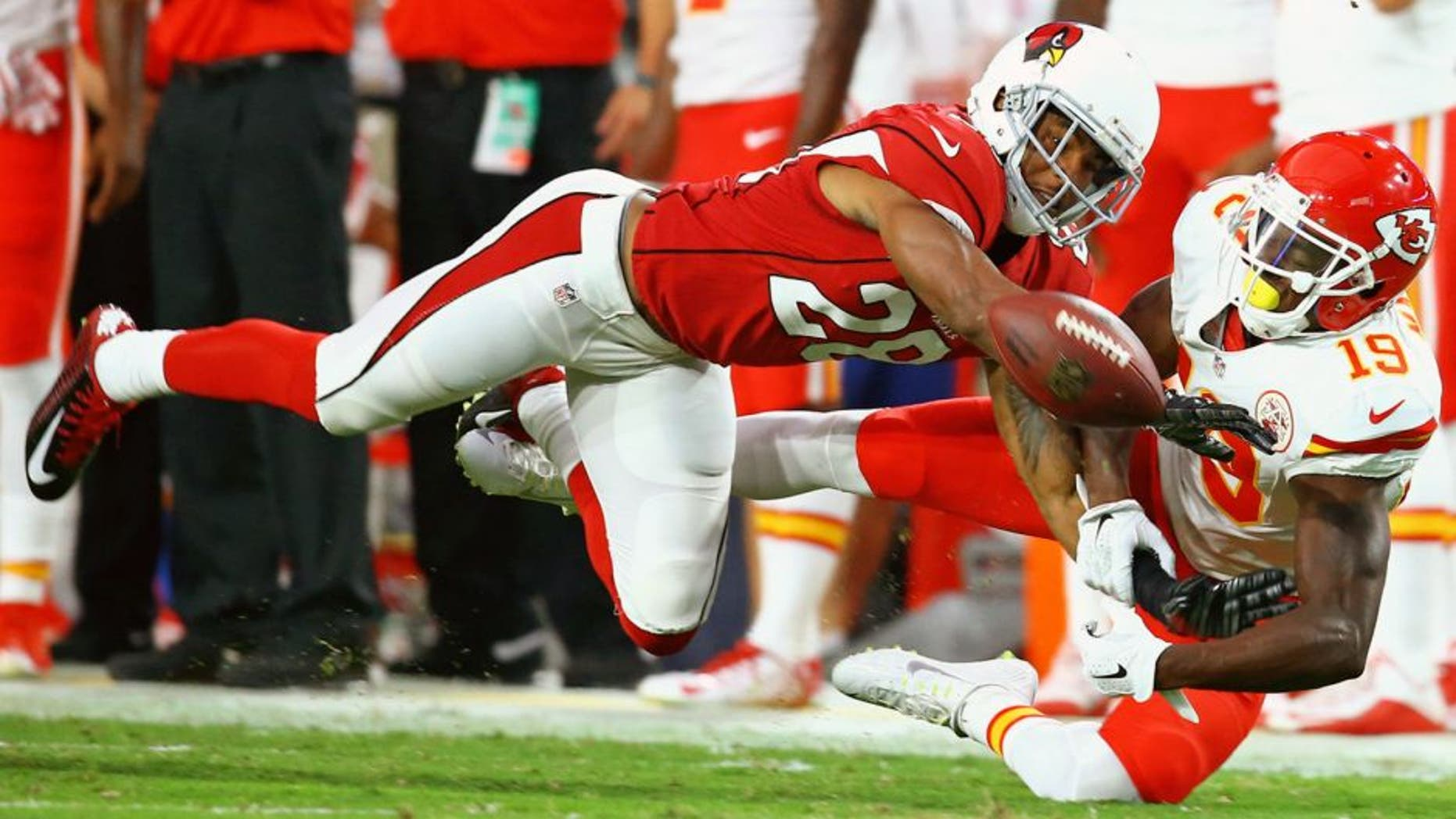 Aug 15, 2015; Glendale, AZ, USA; Arizona Cardinals cornerback Justin Bethel (28) breaks up a pass intended for Kansas City Chiefs wide receiver Jeremy Maclin (19) in a preseason NFL football game at University of Phoenix Stadium. Mandatory Credit: Mark J. Rebilas-USA TODAY Sports