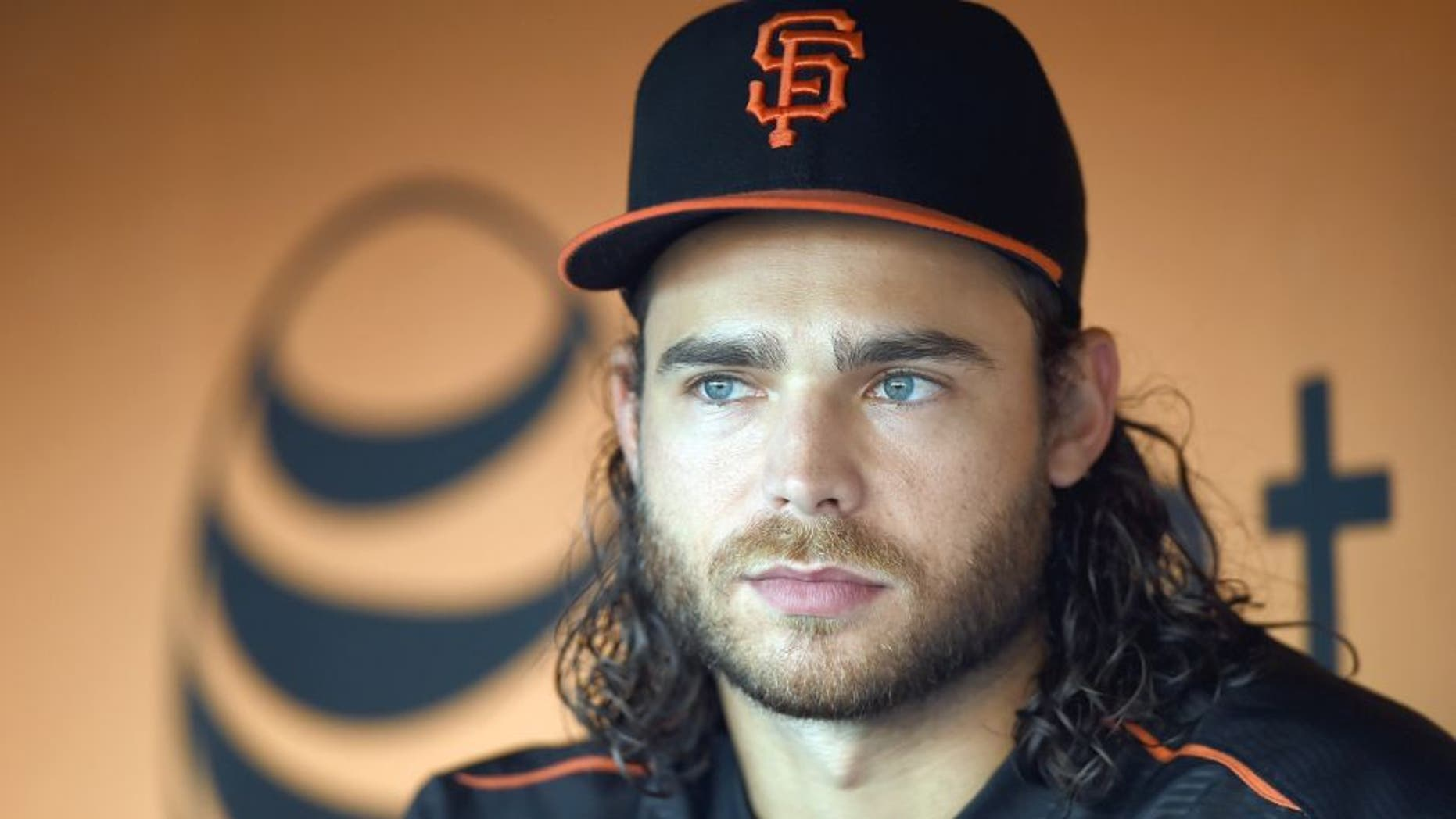SAN FRANCISCO, CA - AUGUST 25: Brandon Crawford #35 of the San Francisco Giants looks on from the dugout during batting practice prior to playing the Chicago Cubs at AT&T Park on August 25, 2015 in San Francisco, California. (Photo by Thearon W. Henderson/Getty Images)