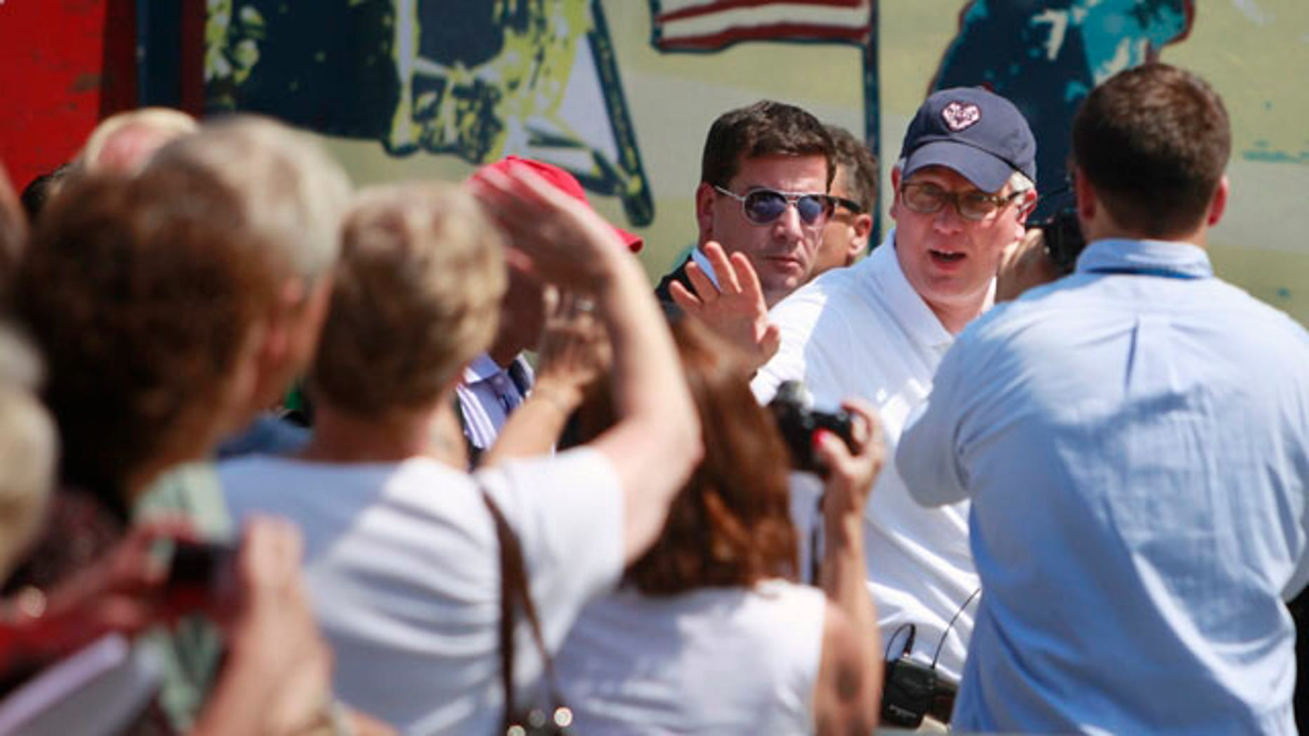 Glenn Beck, right, waves to supporters at the site of the Restoring Honor rally by the Lincoln Memorial in Washington, on Friday, Aug. 27, 2010. The rally will take place on Saturday (AP Photo/Jacquelyn Martin).
