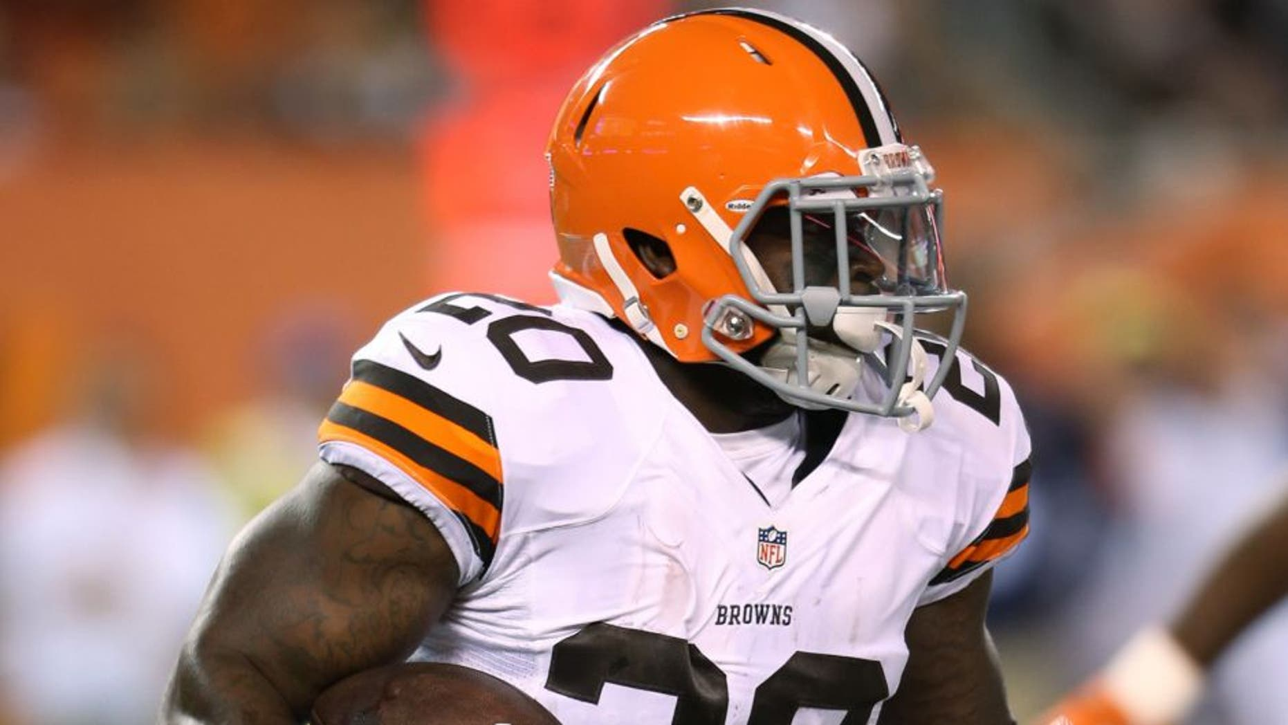 Aug 28, 2014; Cleveland, OH, USA; Cleveland Browns running back Terrance West (20) runs against Chicago Bears during the second quarter at FirstEnergy Stadium. Mandatory Credit: Ron Schwane-USA TODAY Sports