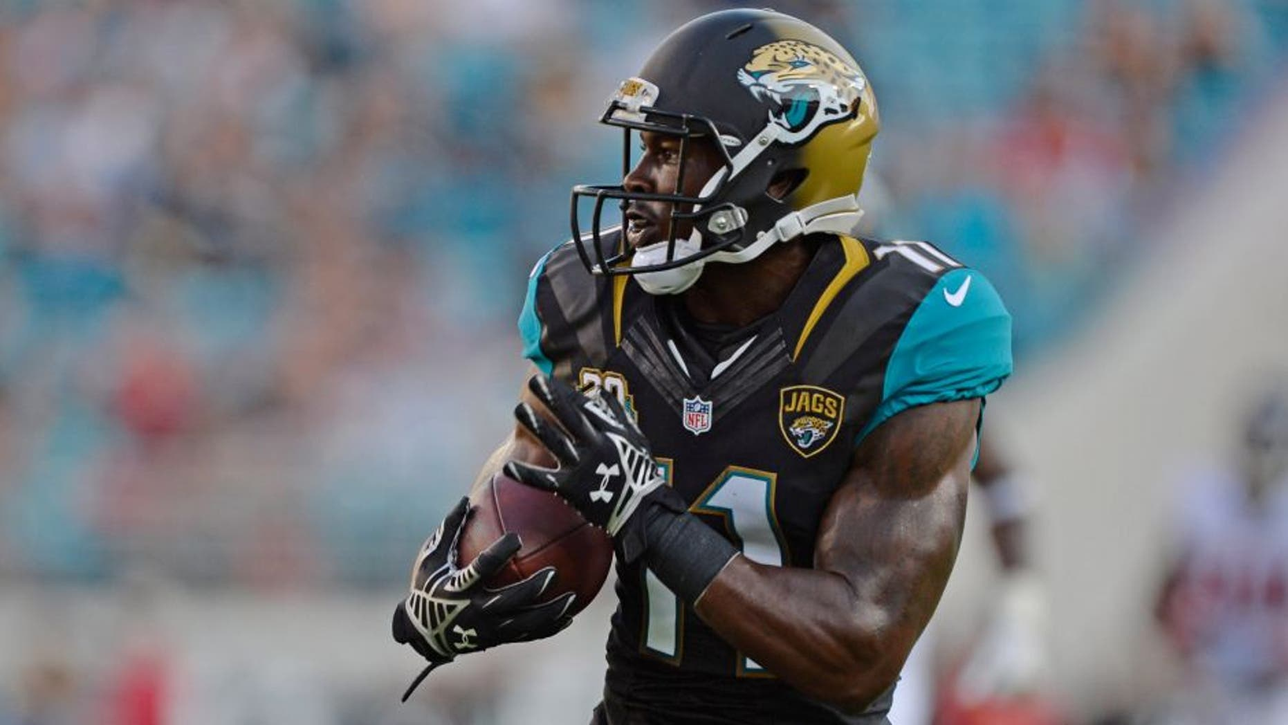 Aug 28, 2014; Jacksonville, FL, USA; Jacksonville Jaguar wide receiver Marqise Lee (11) catches a touchdown pass from quarterback Blake Bortles against the Atlanta Falcons during the 2nd quarter at EverBank Field. Mandatory Credit: Richard Dole-USA TODAY Sports