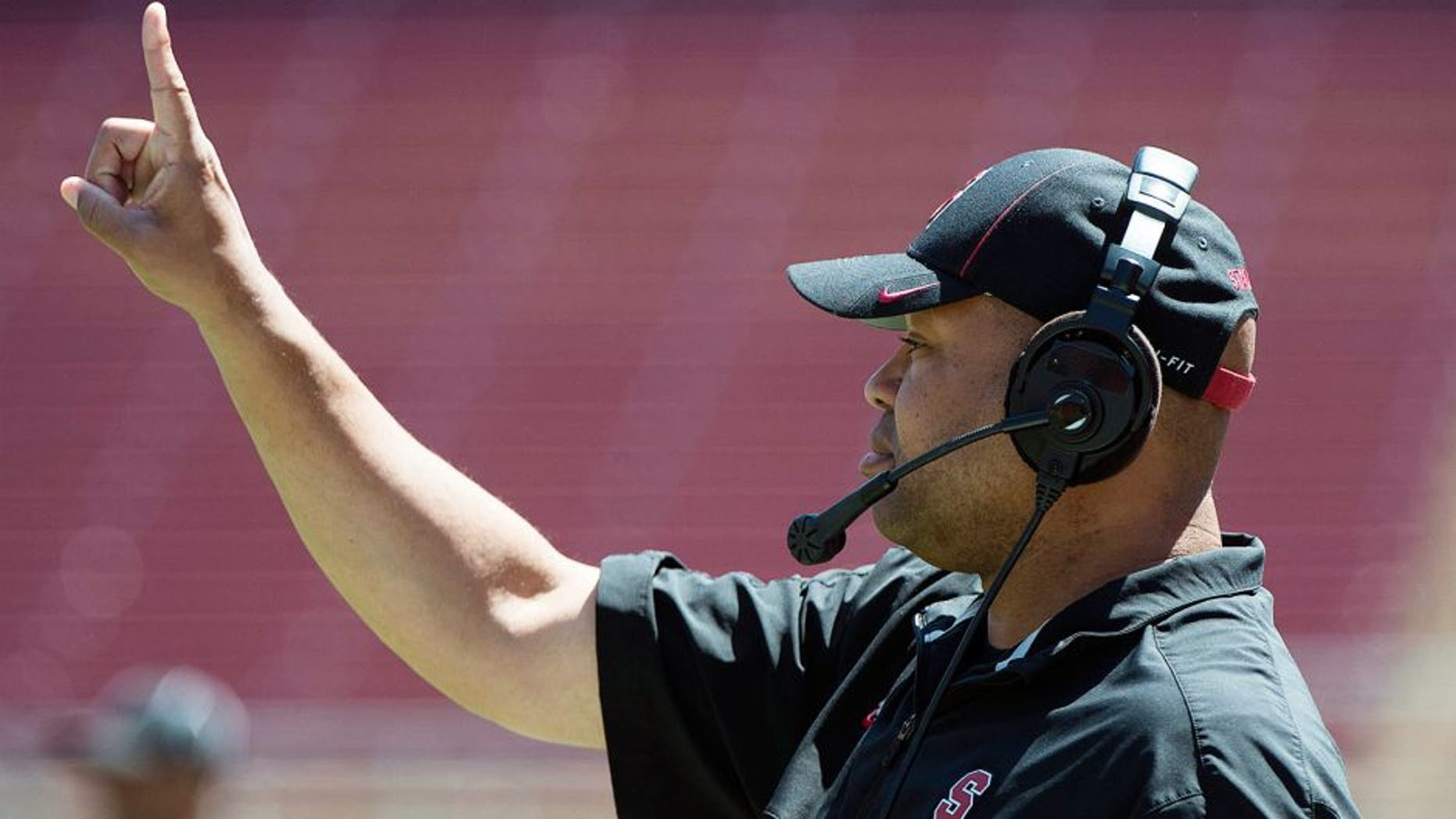 April 12, 2014; Stanford, CA, USA; Stanford Cardinal head coach David Shaw signals during the spring game at Stanford Stadium. Mandatory Credit: Kyle Terada-USA TODAY Sports
