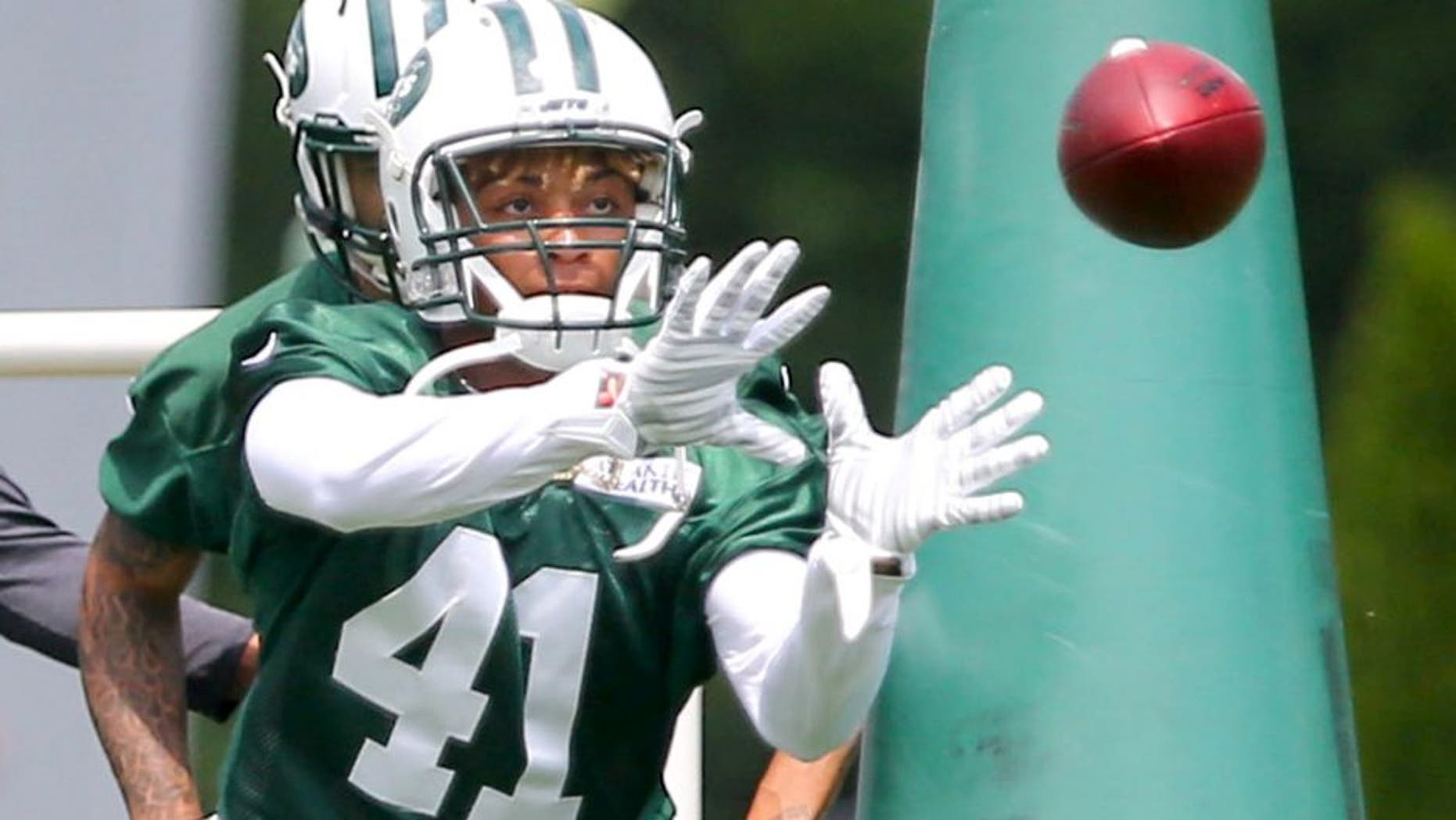 Jun 9, 2015; Florham Park, NJ, USA; New York Jets cornerback Buster Skrine (41) catches a pass during New York Jets minicamp at Atlantic Health Jets Training Center. Mandatory Credit: Ed Mulholland-USA TODAY Sports