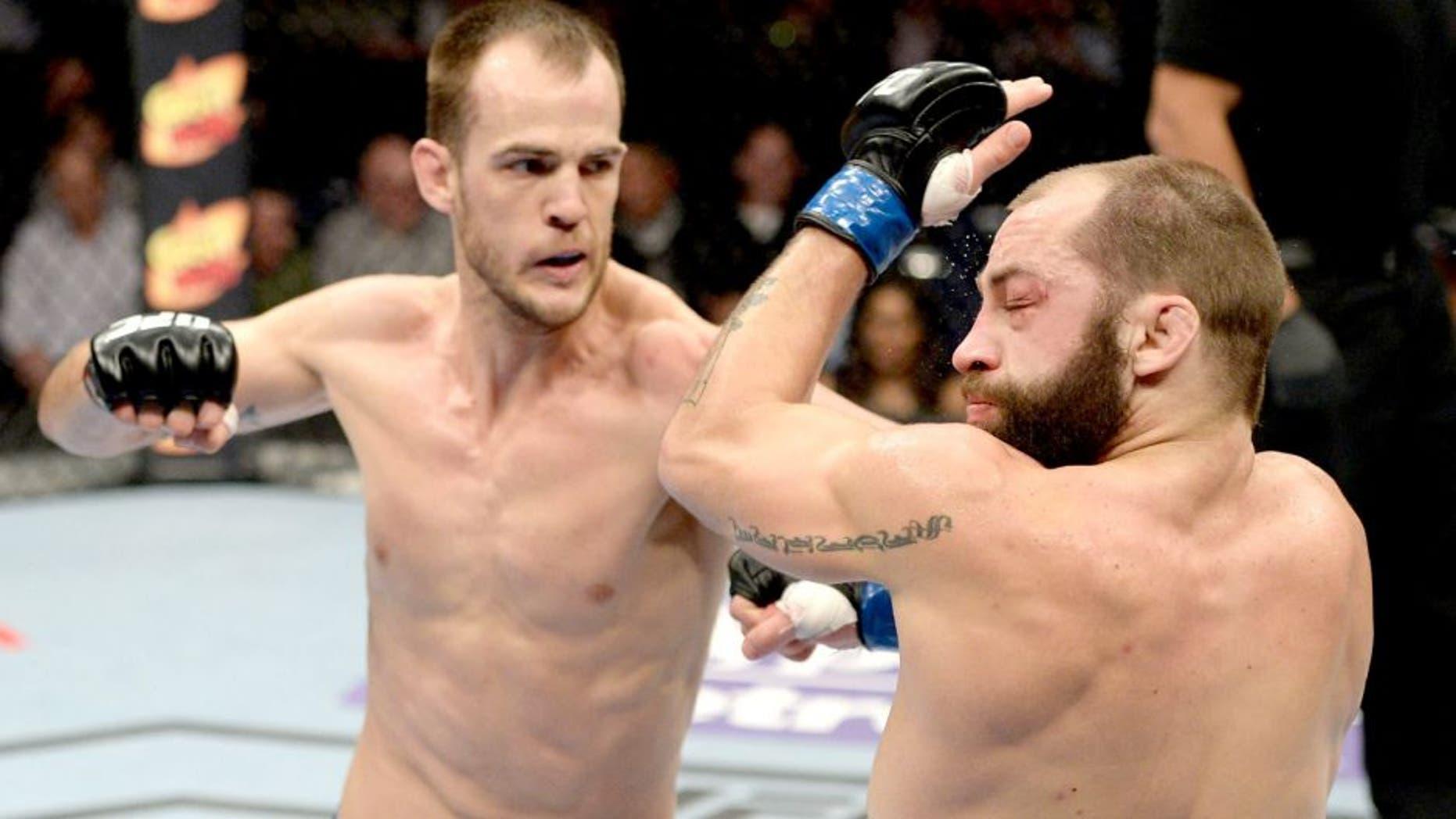 DULUTH, GA - JANUARY 15: (L-R) Cole Miller punches Sam Sicilia in their featherweight fight during the UFC Fight Night event inside The Arena at Gwinnett Center on January 15, 2014 in Duluth, Georgia. (Photo by Jeff Bottari/Zuffa LLC/Zuffa LLC via Getty Images) *** Local Caption *** Sam Sicilia; Cole Miller