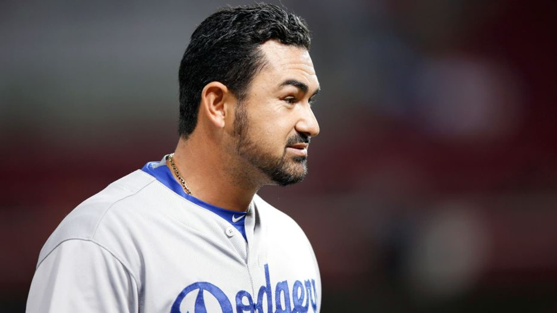 CINCINNATI, OH - AUGUST 26: Adrian Gonzalez #23 of the Los Angeles Dodgers looks on against the Cincinnati Reds during the game at Great American Ball Park on August 26, 2015 in Cincinnati, Ohio. The Dodgers defeated the Reds 7-4. (Photo by Joe Robbins/Getty Images)