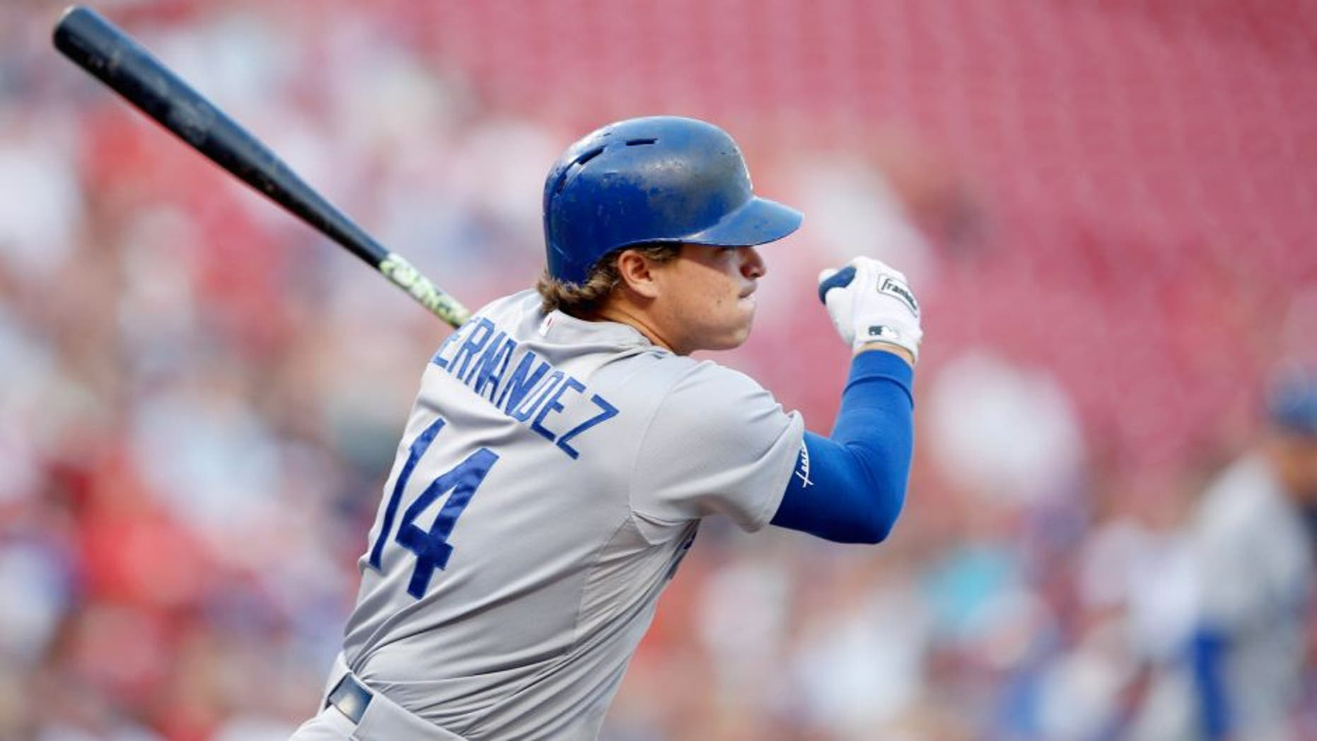 CINCINNATI, OH - AUGUST 26: Enrique Hernandez #14 of the Los Angeles Dodgers singles to right to drive in a run in the second inning against the Cincinnati Reds at Great American Ball Park on August 26, 2015 in Cincinnati, Ohio. (Photo by Joe Robbins/Getty Images)