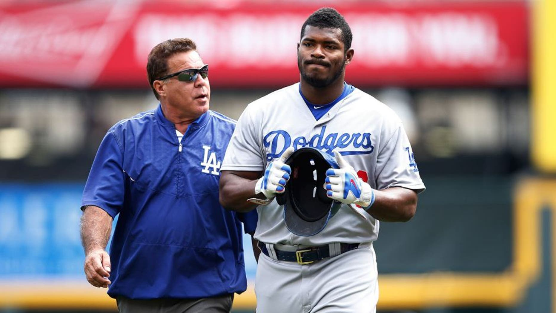CINCINNATI, OH - AUGUST 27: Yasiel Puig #66 of the Los Angeles Dodgers leaves the field after suffering an injury beating out a throw to first base in the ninth inning against the Cincinnati Reds at Great American Ball Park on August 27, 2015 in Cincinnati, Ohio. The Dodgers defeated the Reds 1-0. (Photo by Joe Robbins/Getty Images)