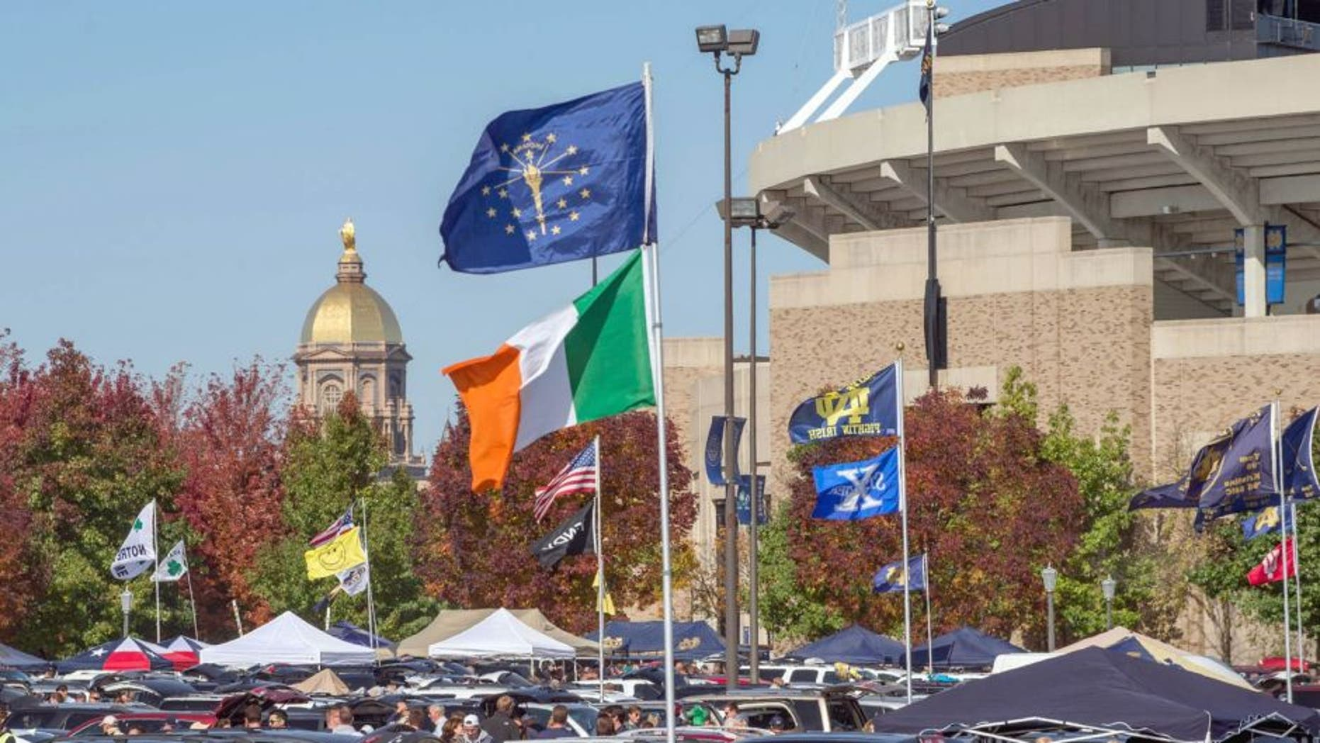 Oct 11, 2014; South Bend, IN, USA; A general view of the golden dome and the stadium at the University of Notre Dame before the game between the Notre Dame Fighting Irish and the North Carolina Tar Heels at Notre Dame Stadium. Mandatory Credit: Matt Cashore-USA TODAY Sports