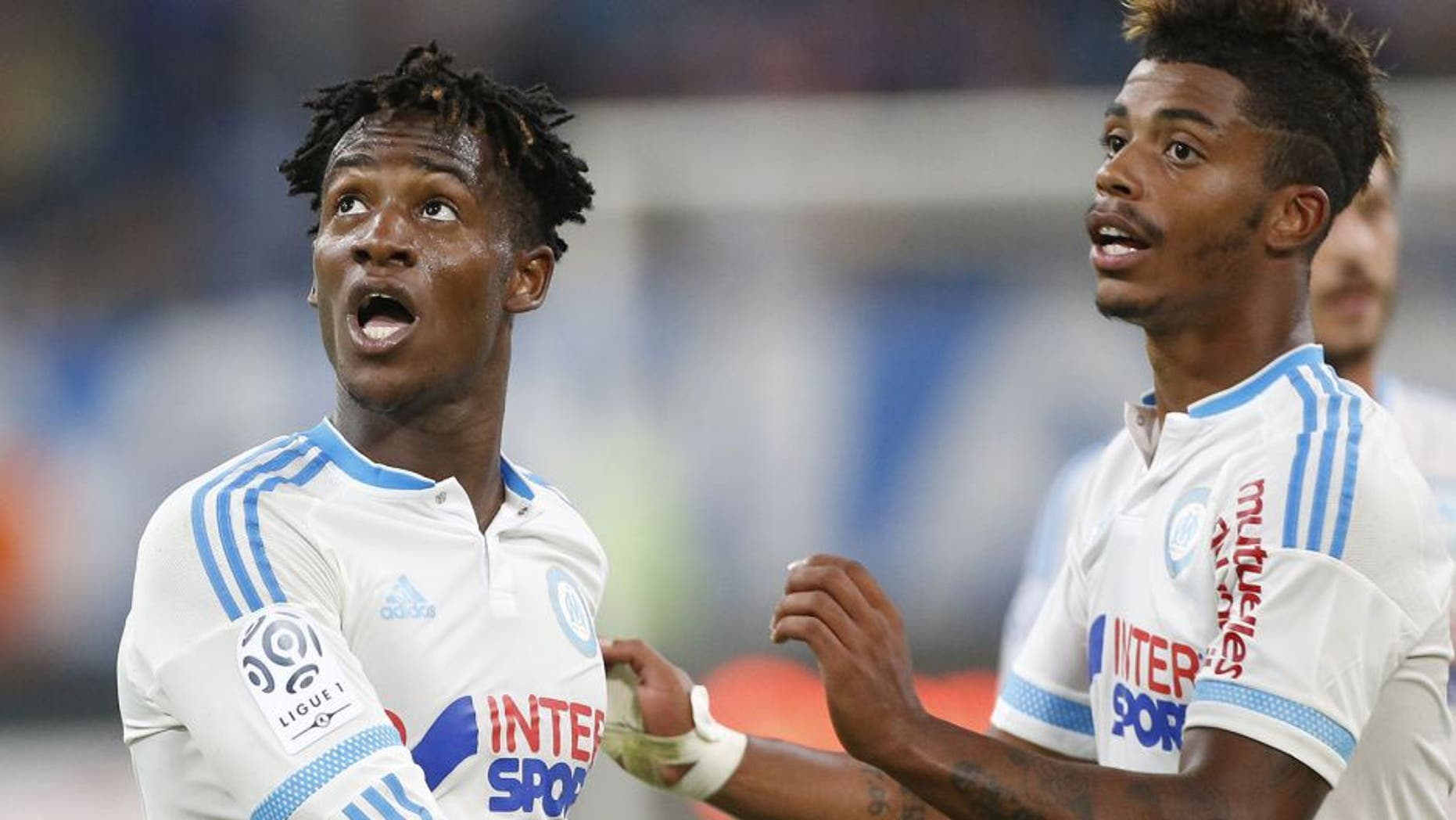 MARSEILLE - AUGUST 23: Michy Batshuayi of OM celebrates his goal with Mario Lemina of OM during the French Ligue 1 match between Olympique de Marseille (OM) and Troyes ESTAC at New Stade Velodrome on August 23, 2015 in Marseille, France. (Photo by Jean Catuffe/Getty Images)