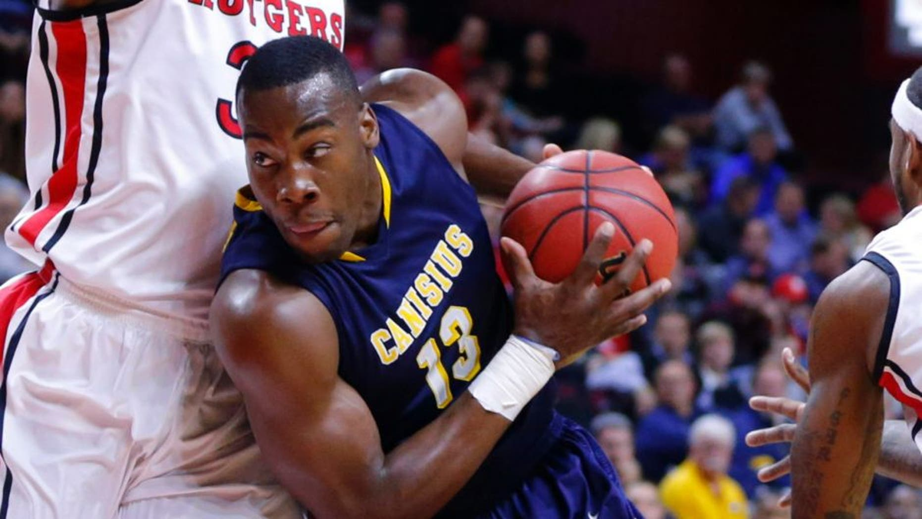 Nov 18, 2013; Piscataway, NJ, USA; Canisius Golden Griffins forward Chris Manhertz (13) drives to the basket during the first half against Rutgers Scarlet Knights forward Wally Judge (33) at the Louis Brown Athletic Center. Mandatory Credit: Jim O'Connor-USA TODAY Sports