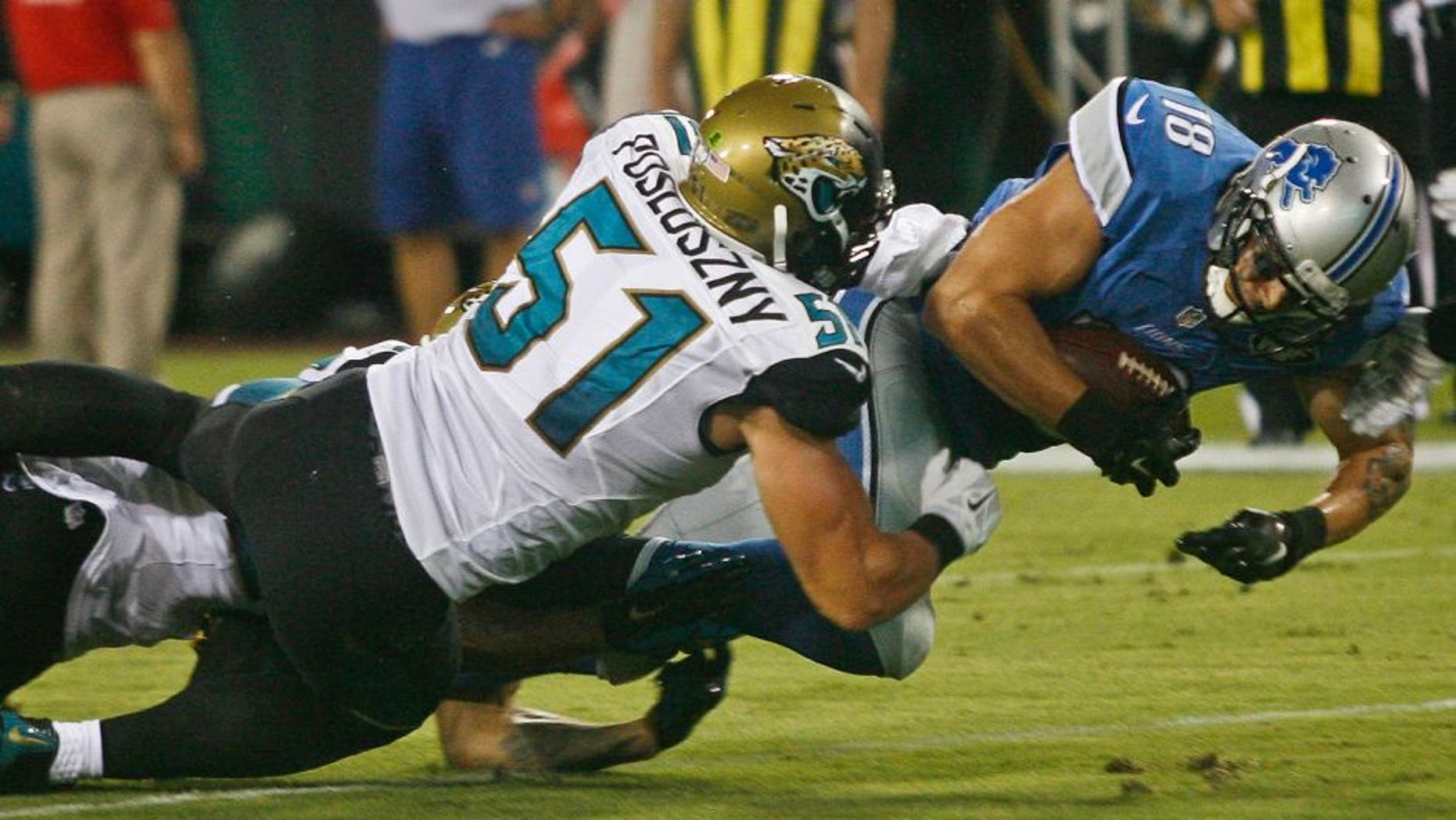 Aug 28, 2015; Jacksonville, FL, USA; Detroit Lions wide receiver Greg Salas (18) dives for extra yardage as Jacksonville Jaguars linebacker Paul Posluszny (51) tackles in the second quarter of a preseason NFL football game at EverBank Field. Mandatory Credit: Phil Sears-USA TODAY Sports