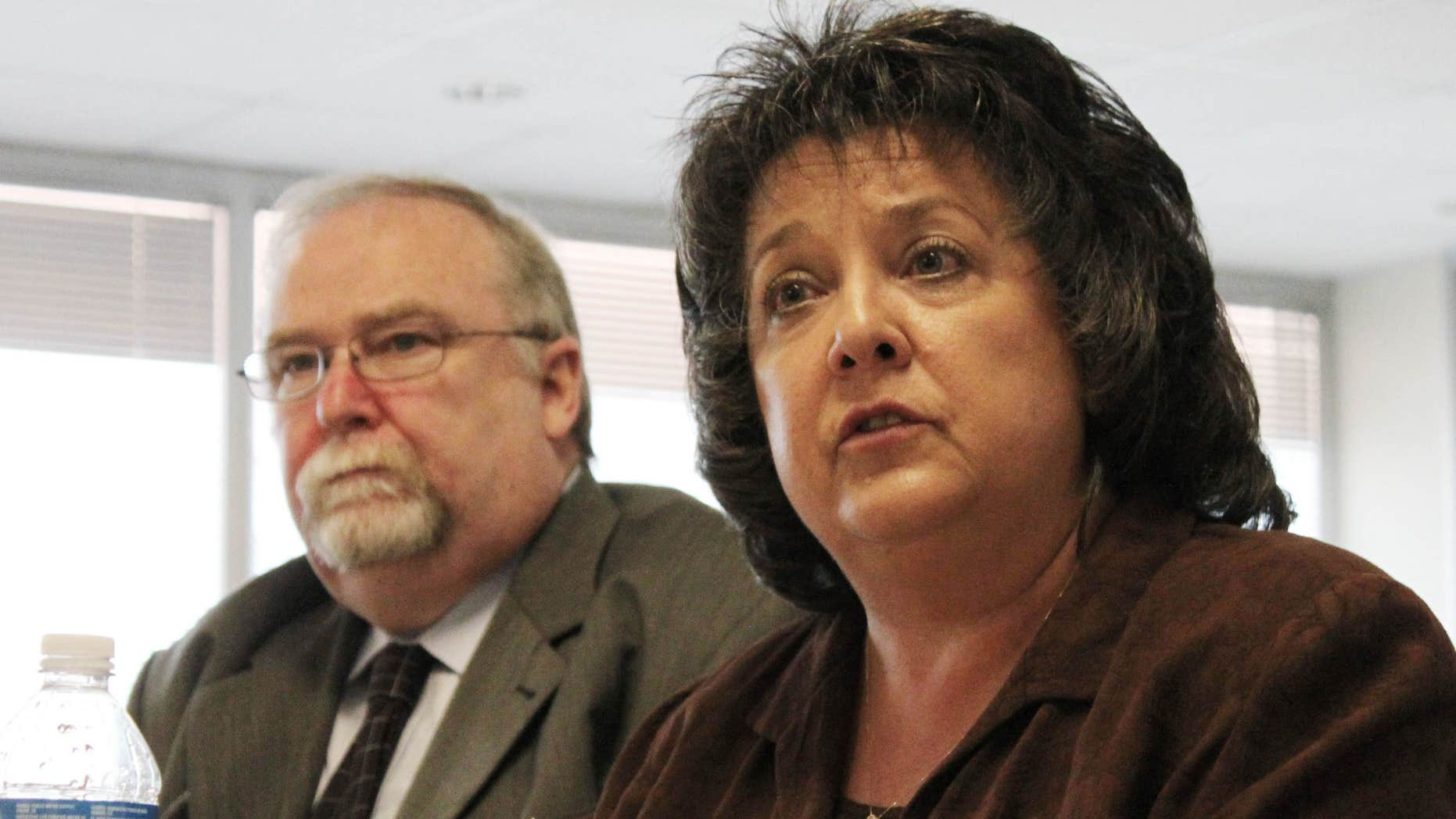 July 16, 2011: Secretary of State Dianna Duran, right, talks about her office's efforts to ensure the accuracy of the state's voter registration rolls during an interim legislative committee hearing in Albuquerque, N.M.