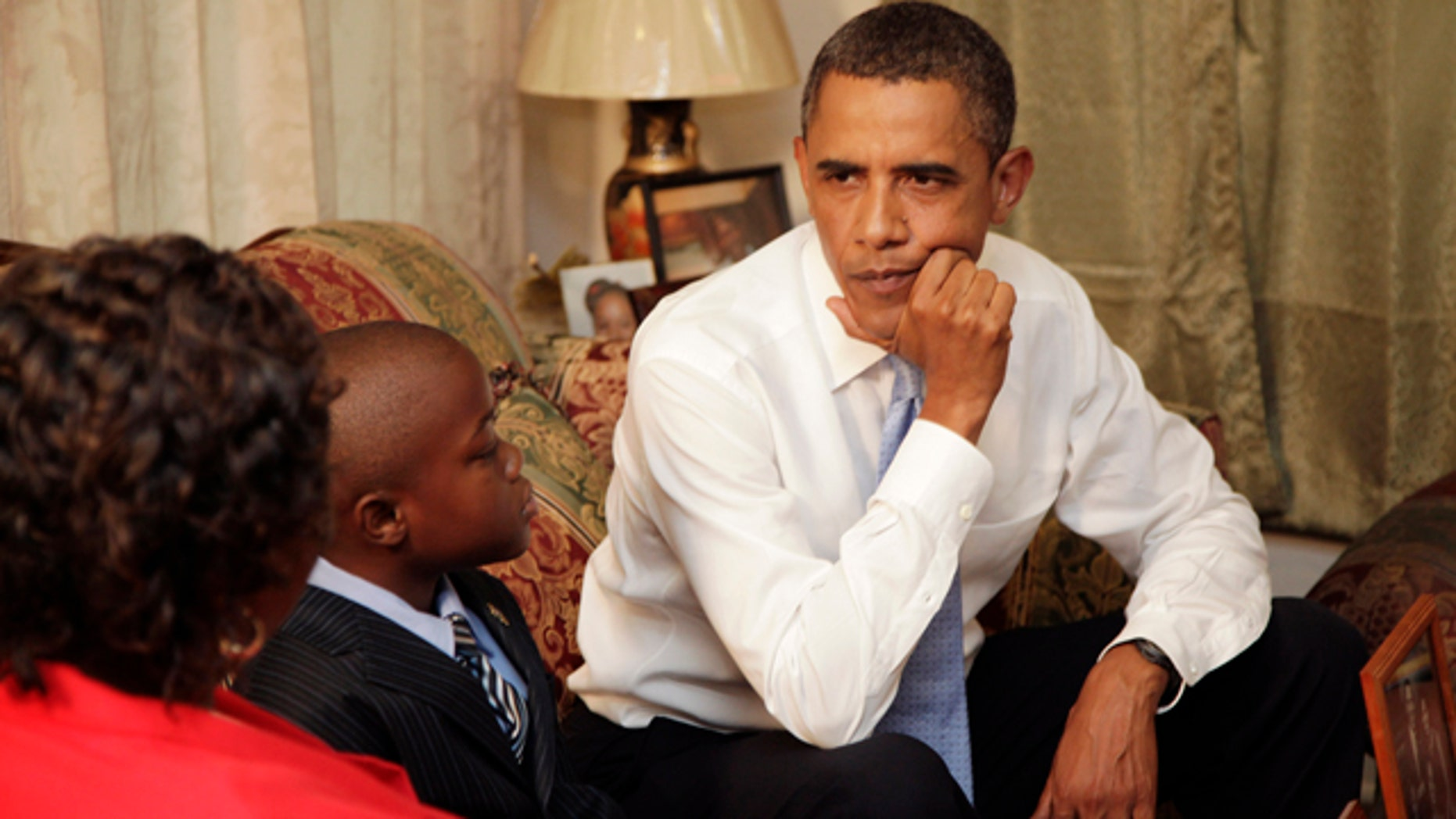 Aug. 29: President Obama talks with resident Maude Smith and her grandson David Robichaux Jr., 9, in her Columbia Parc Development home in New Orleans on the fifth anniversary of Hurricane Katrina.