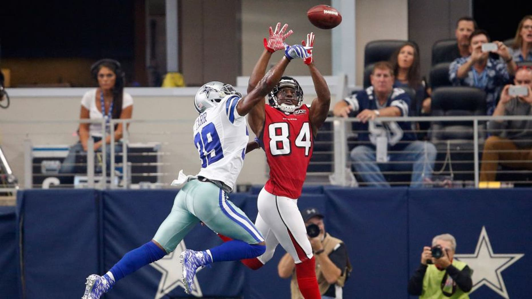 Sep 27, 2015; Arlington, TX, USA; Dallas Cowboys cornerback Brandon Carr (39) breaks up a pass in the end zone against Atlanta Falcons receiver Roddy White (84) in the first quarter at AT&T Stadium. Mandatory Credit: Matthew Emmons-USA TODAY Sports
