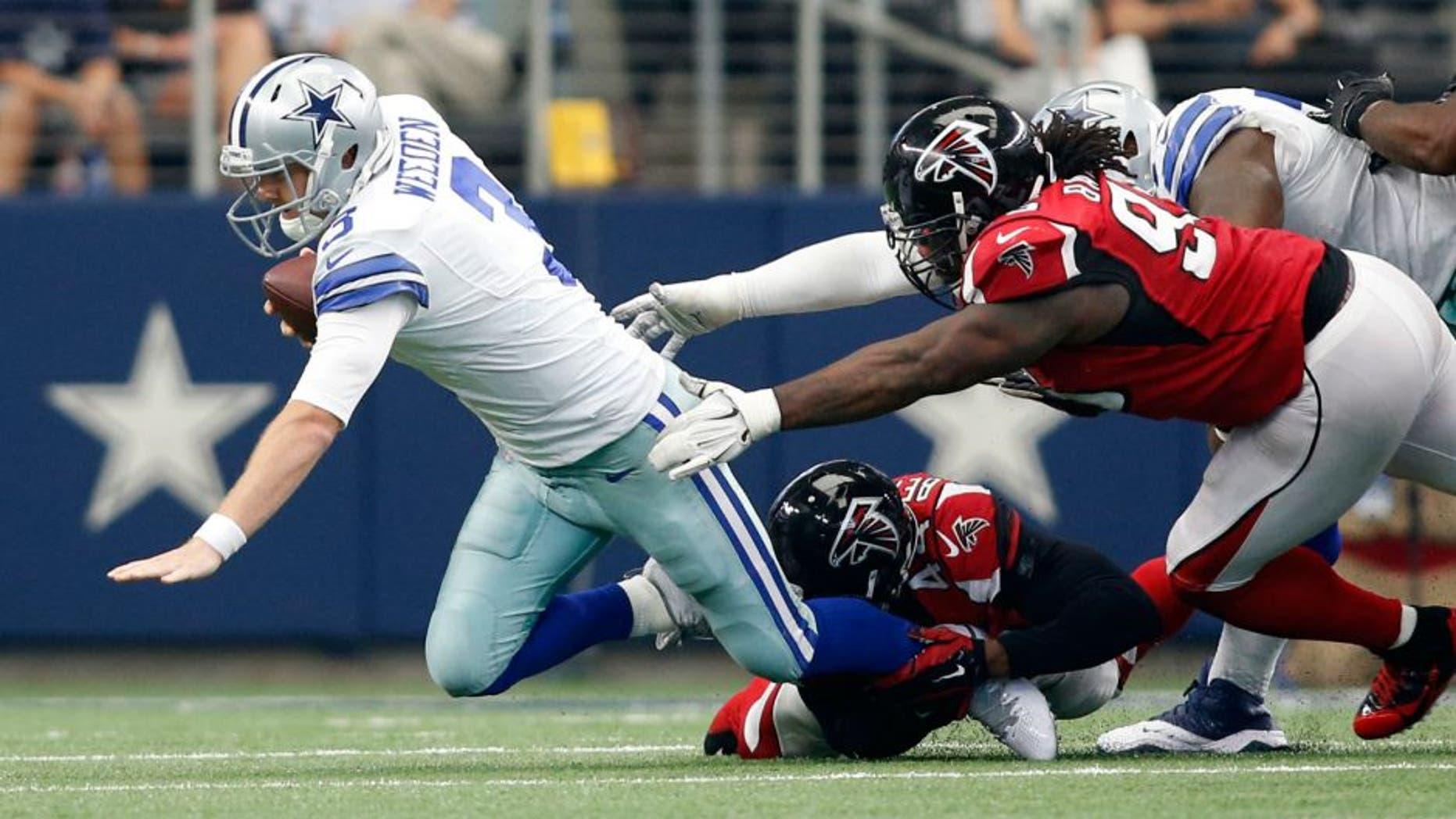 Sep 27, 2015; Arlington, TX, USA; Dallas Cowboys quarterback Brandon Weeden (3) is sacked by Atlanta Falcons linebacker Vic Beasley (44) and defensive tackle Jonathan Babineaux (95) in the fourth quarter in at AT&T Stadium. Atlanta won 39-28. Mandatory Credit: Tim Heitman-USA TODAY Sports