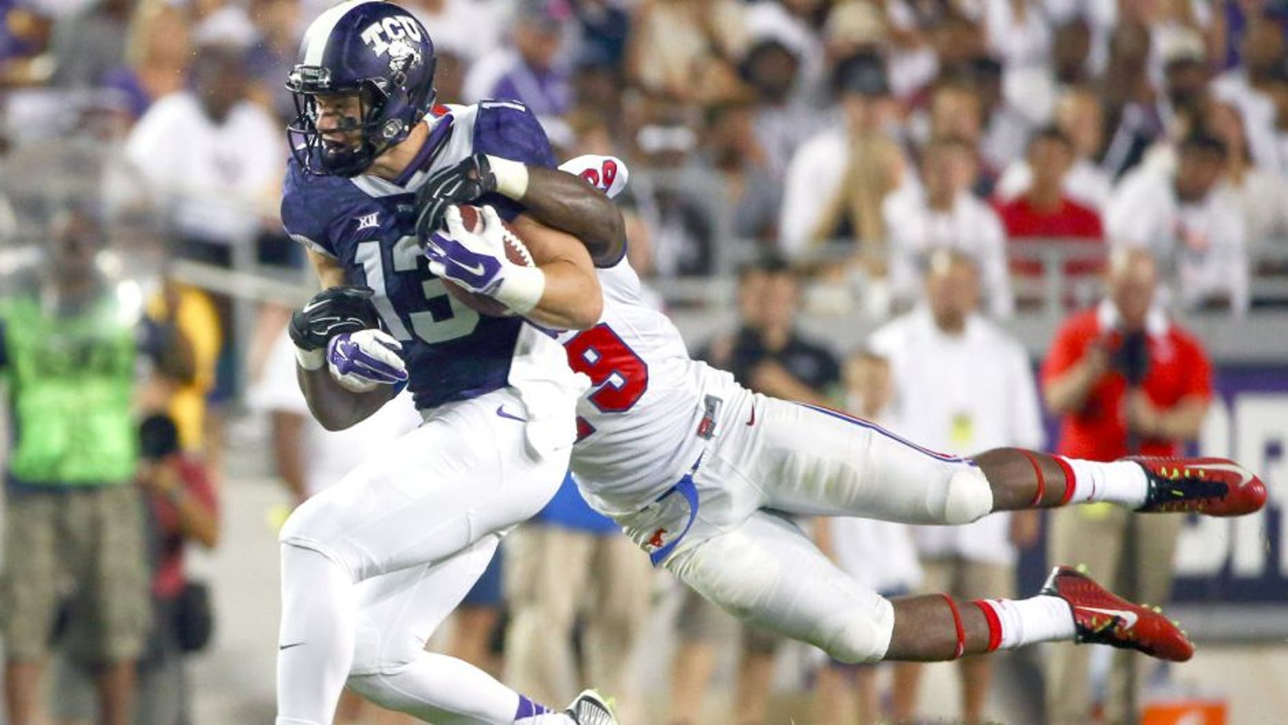 Sep 19, 2015; Fort Worth, TX, USA; TCU Horned Frogs wide receiver Ty Slanina (13) runs with the ball as Southern Methodist Mustangs defensive back Darrion Richardson (29) defends during the first half at Amon G. Carter Stadium. Mandatory Credit: Kevin Jairaj-USA TODAY Sports