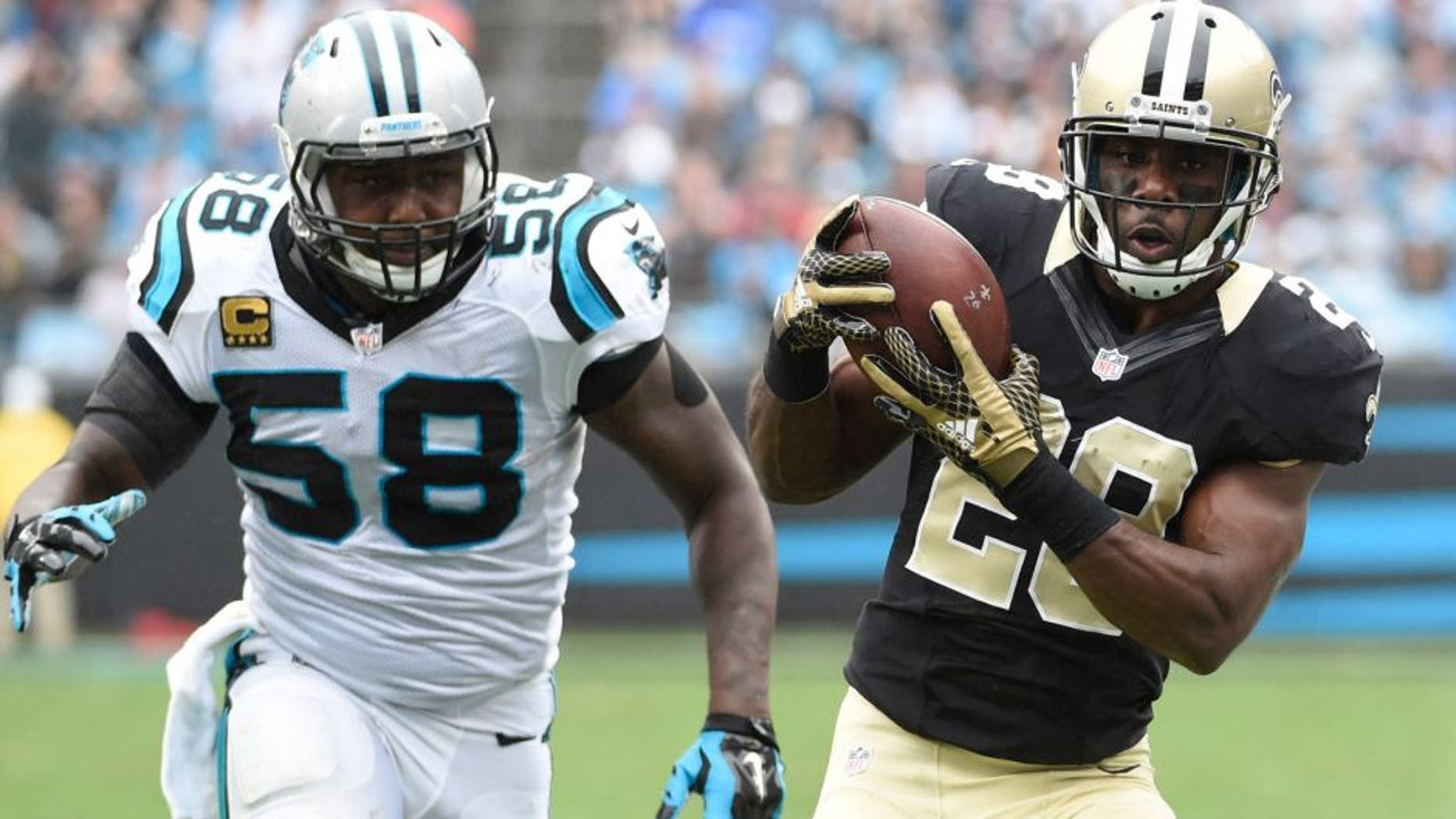 Sep 27, 2015; Charlotte, NC, USA; New Orleans Saints running back C.J. Spiller (28) with the ball as Carolina Panthers outside linebacker Thomas Davis (58) defends in the fourth quarter. The Panthers defeated the Saints 27-22 at Bank of America Stadium. Mandatory Credit: Bob Donnan-USA TODAY Sports