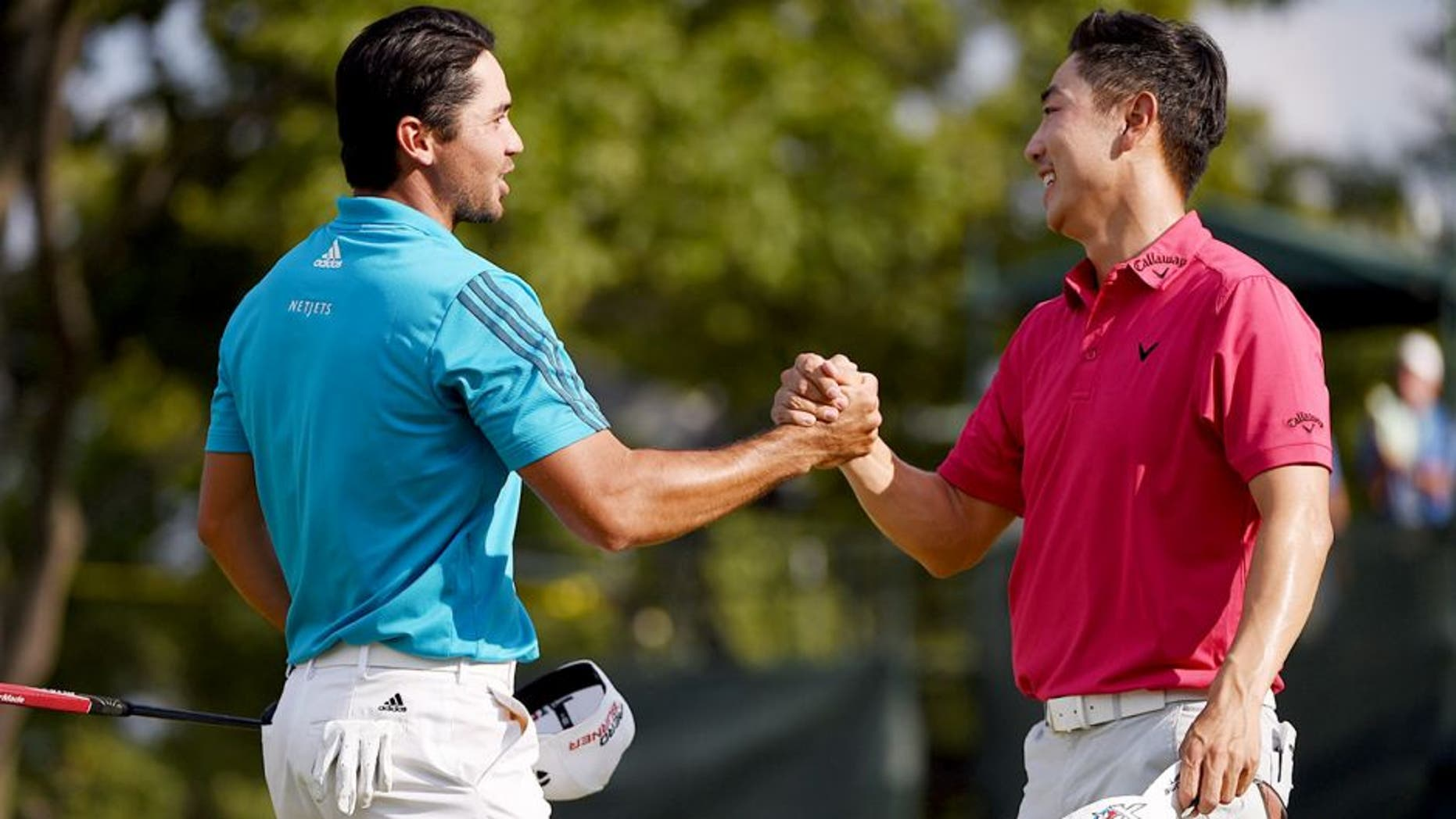 EDISON, NJ - AUGUST 29: Jason Day of Australia (L) and Sang-Moon Bae of Korea shake hands on the18th green during the third round of The Barclays at Plainfield Country Club on August 29, 2015 in Edison, New Jersey. (Photo by Ross Kinnaird/Getty Images)