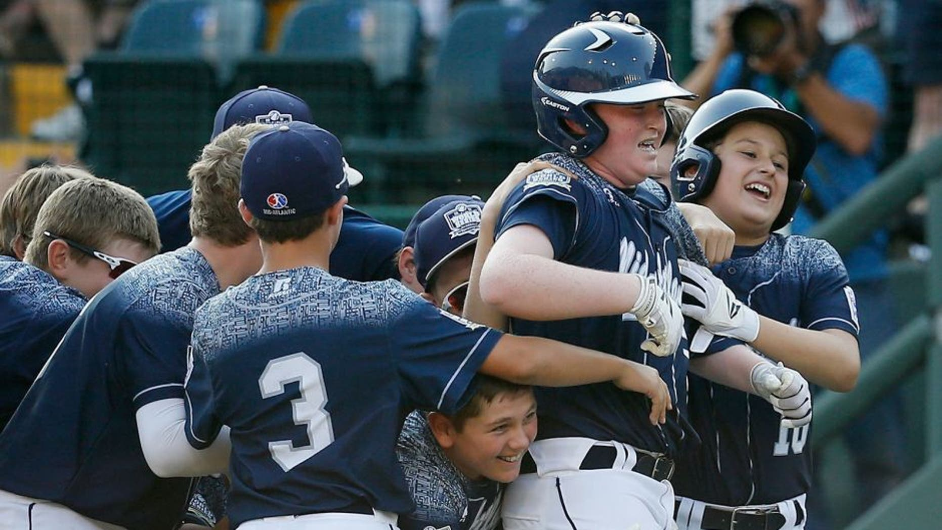 SOUTH WILLAMSPORT, PA - AUGUST 29: Clayton Krauss #25 of the Mid-Atlantic team from Red Land Little League of Lewisberry, Pennsylvania (C) celebrates with teammates after hitting a walk off single against the Southwest team from Pearland West Little League of Pearland, Texas for a 3-2 win during the United States Championship game of the Little League World Series at Lamade Stadium on August 29, 2015 in South Willamsport, Pennsylvania. (Photo by Rob Carr/Getty Images)