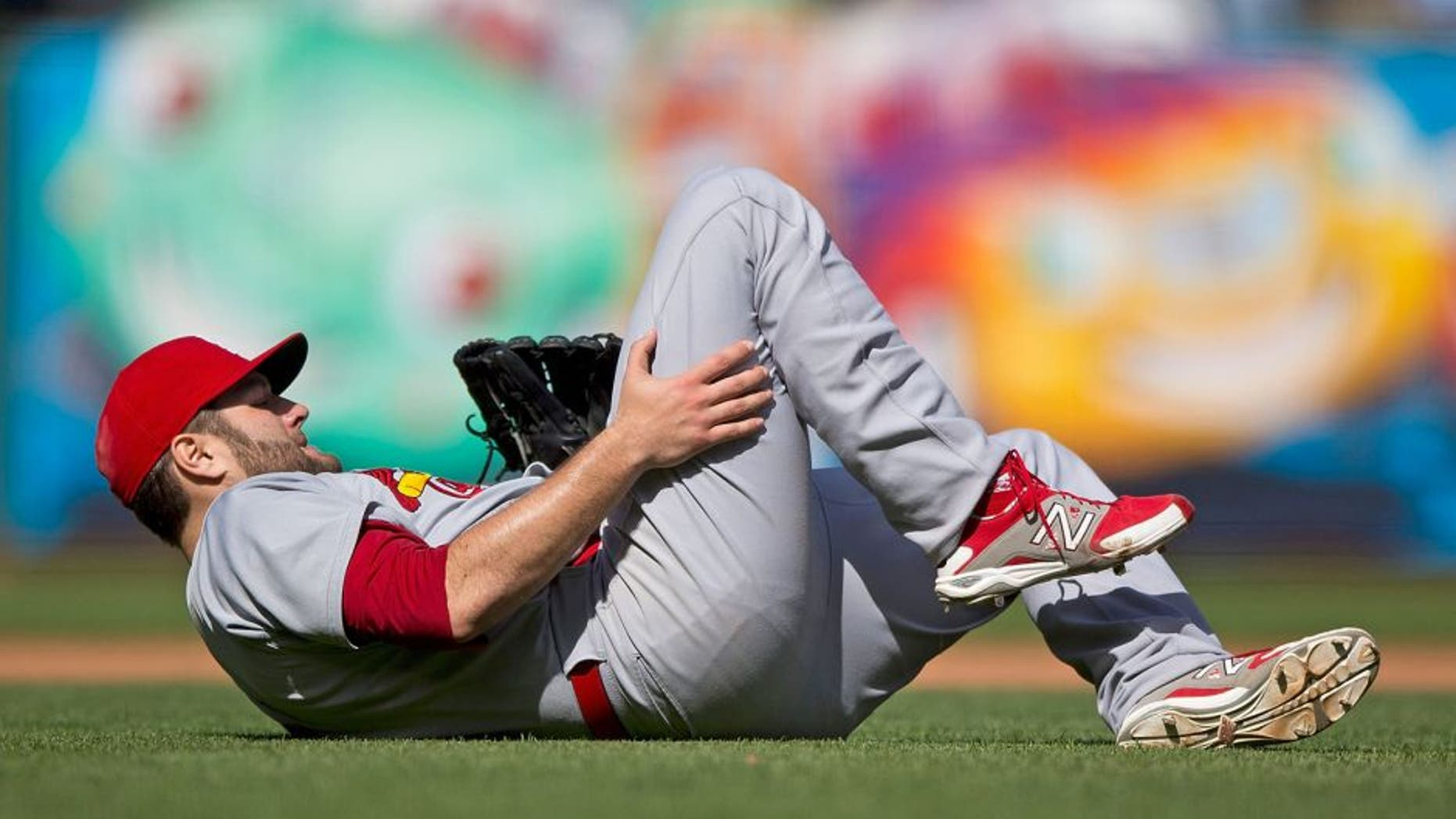 SAN FRANCISCO, CA - AUGUST 29: Lance Lynn #31 of the St. Louis Cardinals injures his leg after throwing to first base against the San Francisco Giants during the eighth inning at AT&T Park on August 29, 2015 in San Francisco, California. The St. Louis Cardinals defeated the San Francisco Giants 6-0. (Photo by Jason O. Watson/Getty Images)