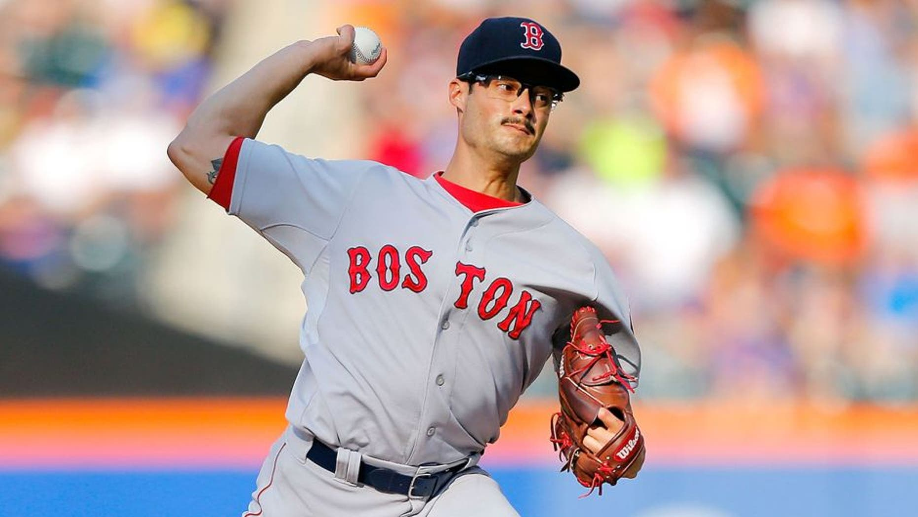 NEW YORK, NY - AUGUST 29: Joe Kelly #56 of the Boston Red Sox pitches in the third inning against the New York Mets at Citi Field on August 29, 2015 in the Flushing neighborhood of the Queens borough of New York City. (Photo by Jim McIsaac/Getty Images)