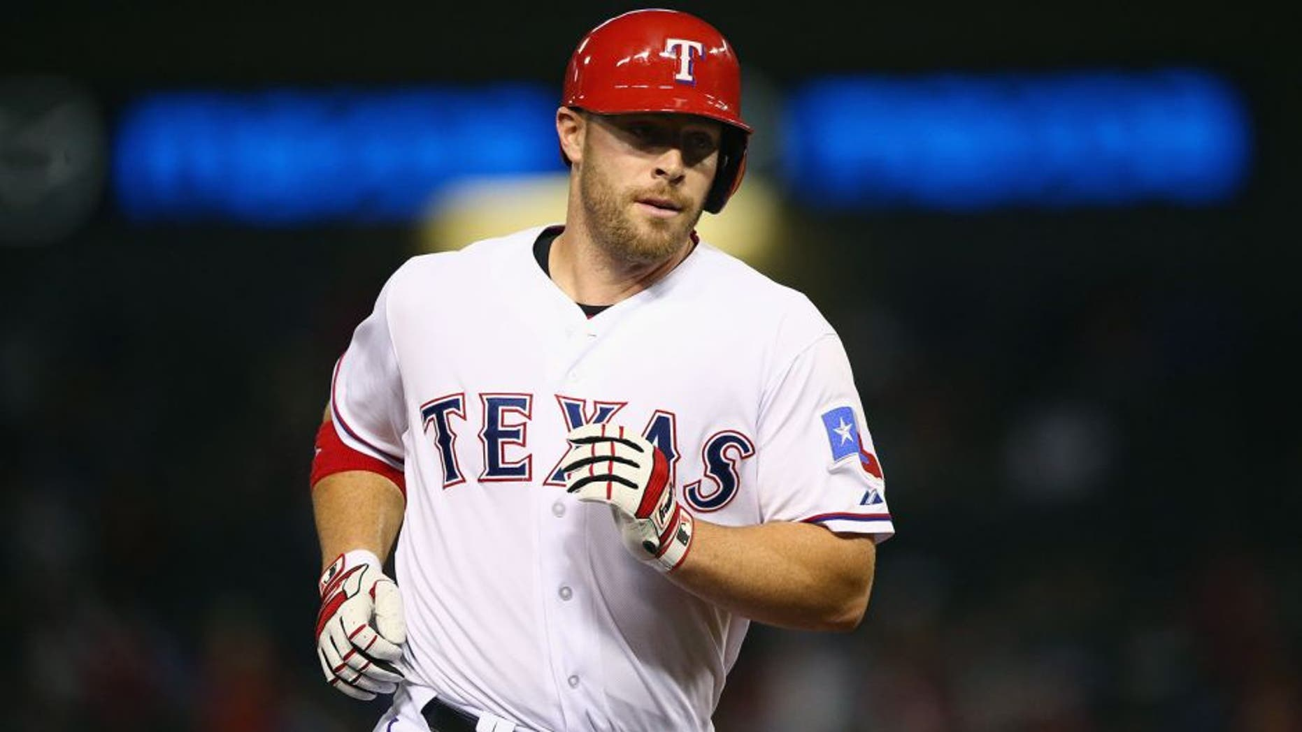 ARLINGTON, TX - AUGUST 28: Chris Gimenez #38 of the Texas Rangers hits a home run in the fifth inning against the Baltimore Orioles at Globe Life Park in Arlington on August 28, 2015 in Arlington, Texas. (Photo by Ronald Martinez/Getty Images)