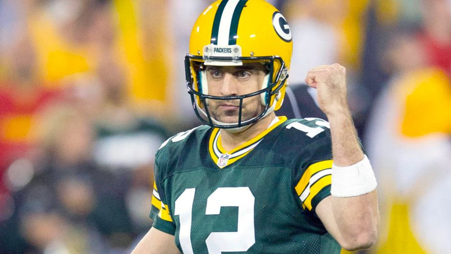 Sep 28, 2015; Green Bay, WI, USA; Green Bay Packers quarterback Aaron Rodgers (12) celebrates a touchdown pass during the first quarter against the Kansas City Chiefs at Lambeau Field. Mandatory Credit: Jeff Hanisch-USA TODAY Sports
