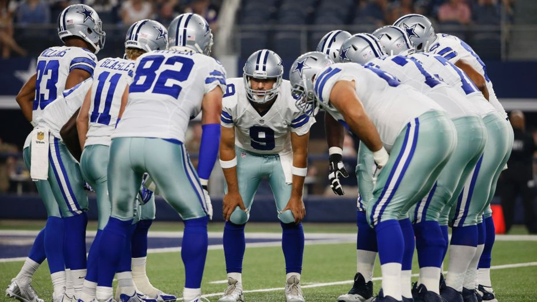 Dallas Cowboys quarterback Tony Romo (9) huddles with the team against the Minnesota Vikings during the first half of a preseason NFL football game Saturday, Aug. 29, 2015, in Arlington, Texas. (AP Photo/Tony Gutierrez)