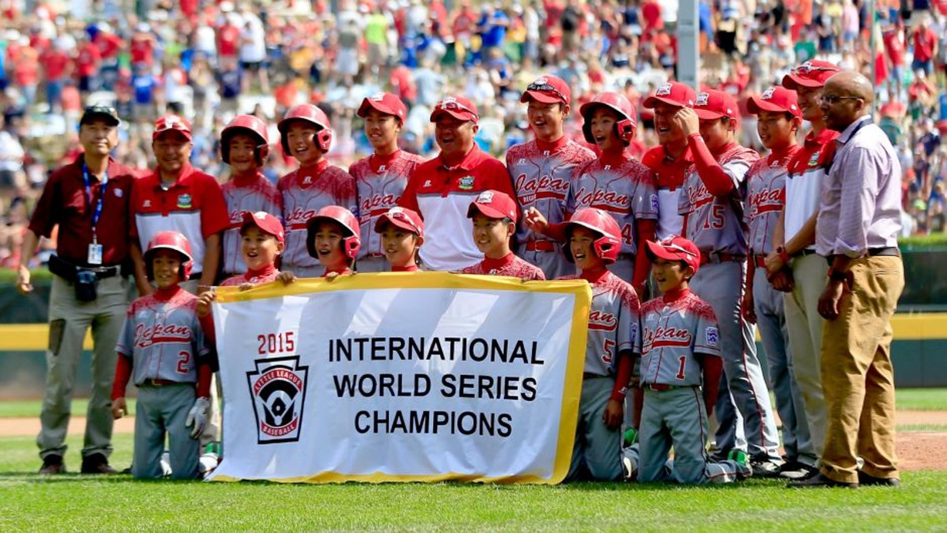 SOUTH WILLAMSPORT, PA - AUGUST 29: Members of team Japan pose with the banner after defeating team Mexico during the International Championship game of the Little League World Series at Lamade Stadium on August 29, 2015 in South Willamsport, Pennsylvania. (Photo by Rob Carr/Getty Images)