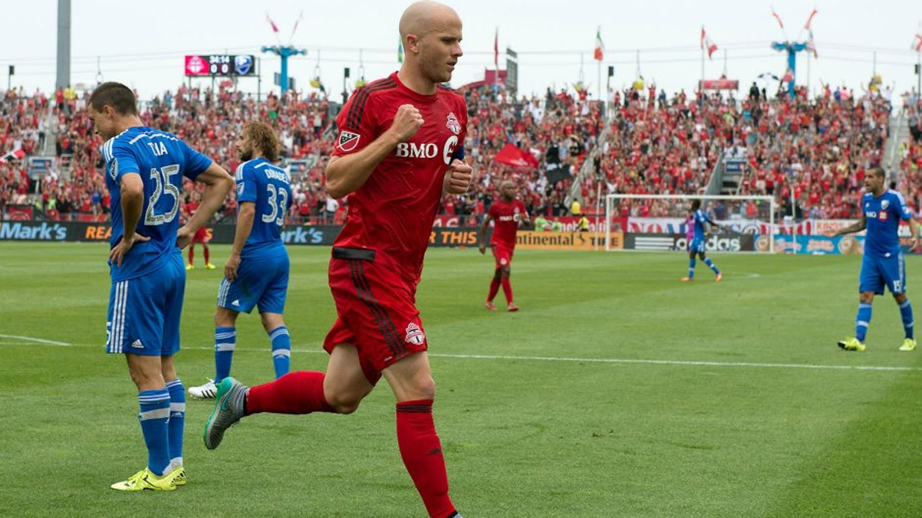 Aug 29, 2015; Toronto, Ontario, CAN; Toronto FC midfielder Michael Bradley (4) celebrates after scoring a goal during the first half in a game against the Montreal Impact at BMO Field. Mandatory Credit: Nick Turchiaro-USA TODAY Sports