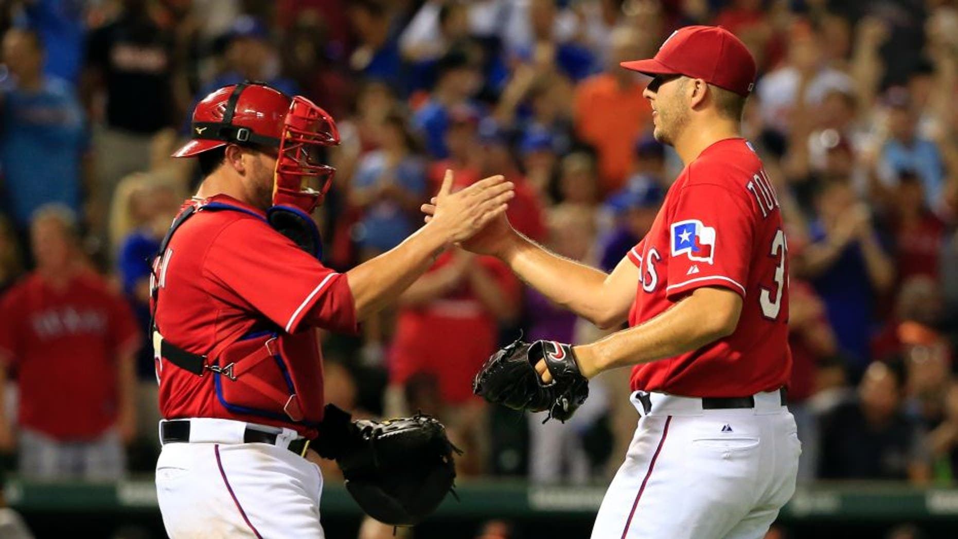 Aug 29, 2015; Arlington, TX, USA; Texas Rangers catcher Bobby Wilson (left) celebrates with relief pitcher Shawn Tolleson (37) after the victory against the Baltimore Orioles at Globe Life Park in Arlington. Mandatory Credit: Kevin Jairaj-USA TODAY Sports