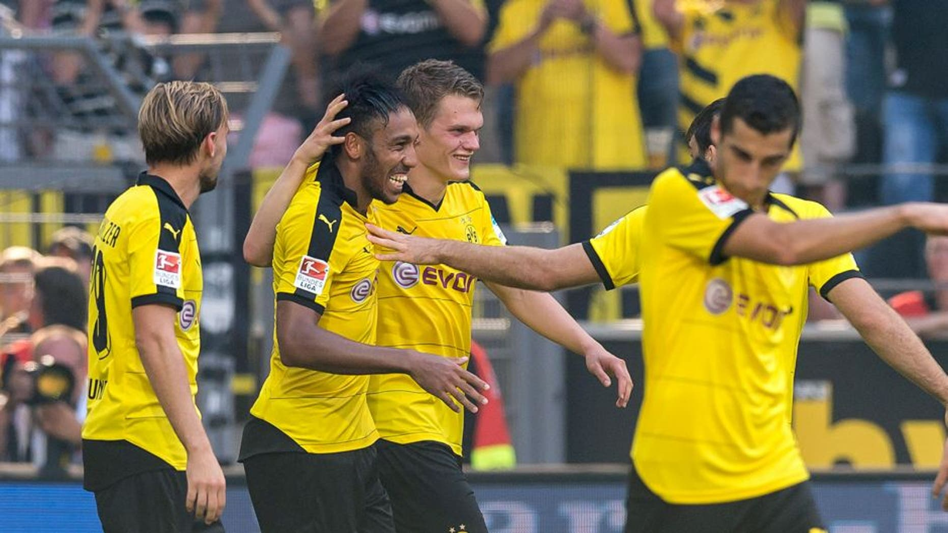 DORTMUND, GERMANY - AUGUST 30: Pierre-Emerick Aubameyang of Borussia Dortmund celebrates scoring the goal to the 2:0 together with his team mates Matthias Ginter, Marcel Schmelzer and Henrikh Mkhitaryan during the Bundesliga match between Borussia Dortmund and Hertha BSC at Signal Iduna Park on August 30, 2015 in Dortmund, Germany. (Photo by Alexandre Simoes/Borussia Dortmund/Getty Images)