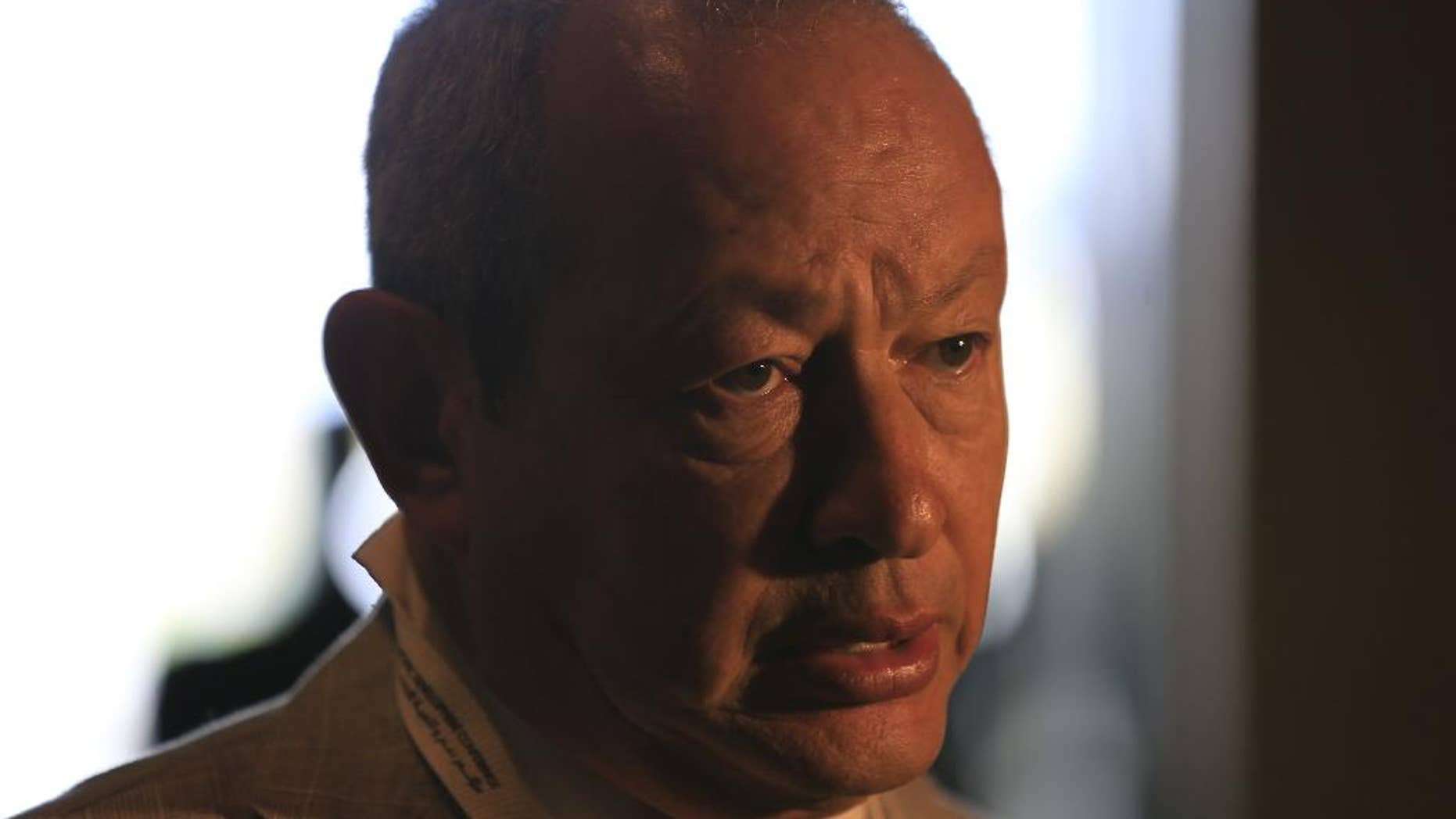 Egyptian billionaire businessman Naguib Sawiris speaks to journalists prior to the opening of a major economic conference seeking billions of dollars in investment, in Sharm el-Sheikh, Egypt, Friday, March 13, 2015. Egyptian President Abdel-Fattah el-Sissi approved a package of amendments to investment laws on Thursday, aimed at enticing foreign investors on the eve of the conference that will bring together hundreds of business executives and foreign leaders. (AP Photo/Hassan Ammar)