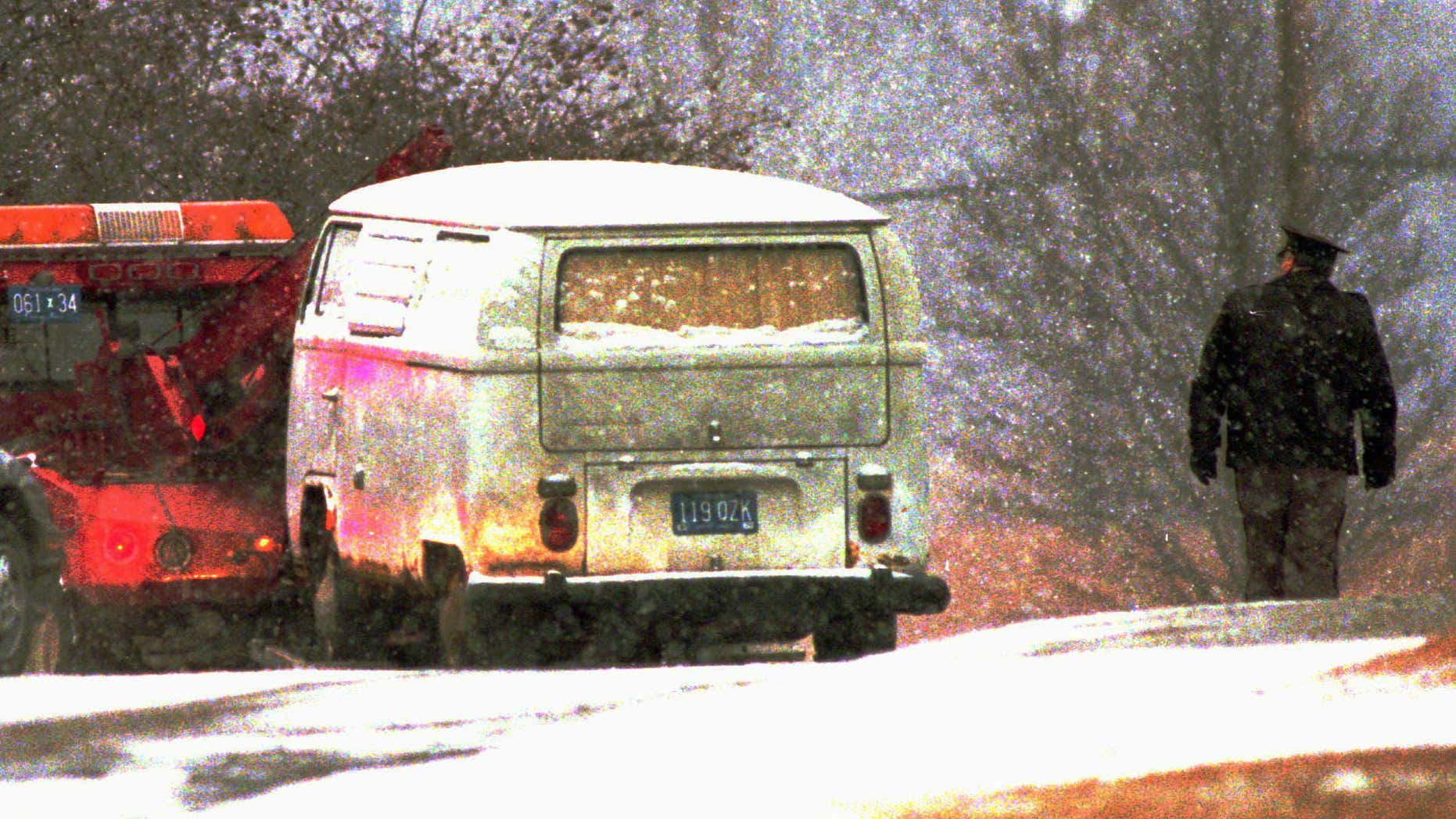 Jan. 29, 1996: A truck pulls Dr. Jack Kevorkian's minivan, which authorities said contained the body of a woman, away from a parking lot at the Medical Examiner's office in Pontiac, Mich.