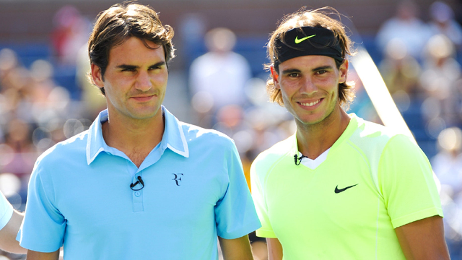 Tennis players Roger Federer, left, and Rafael Nadal look on during Arthur Ashe Kids Day at the USTA Billie Jean King National Tennis Center on Saturday, Aug. 28, 2010 in New York. (AP Photo/Evan Agostini)