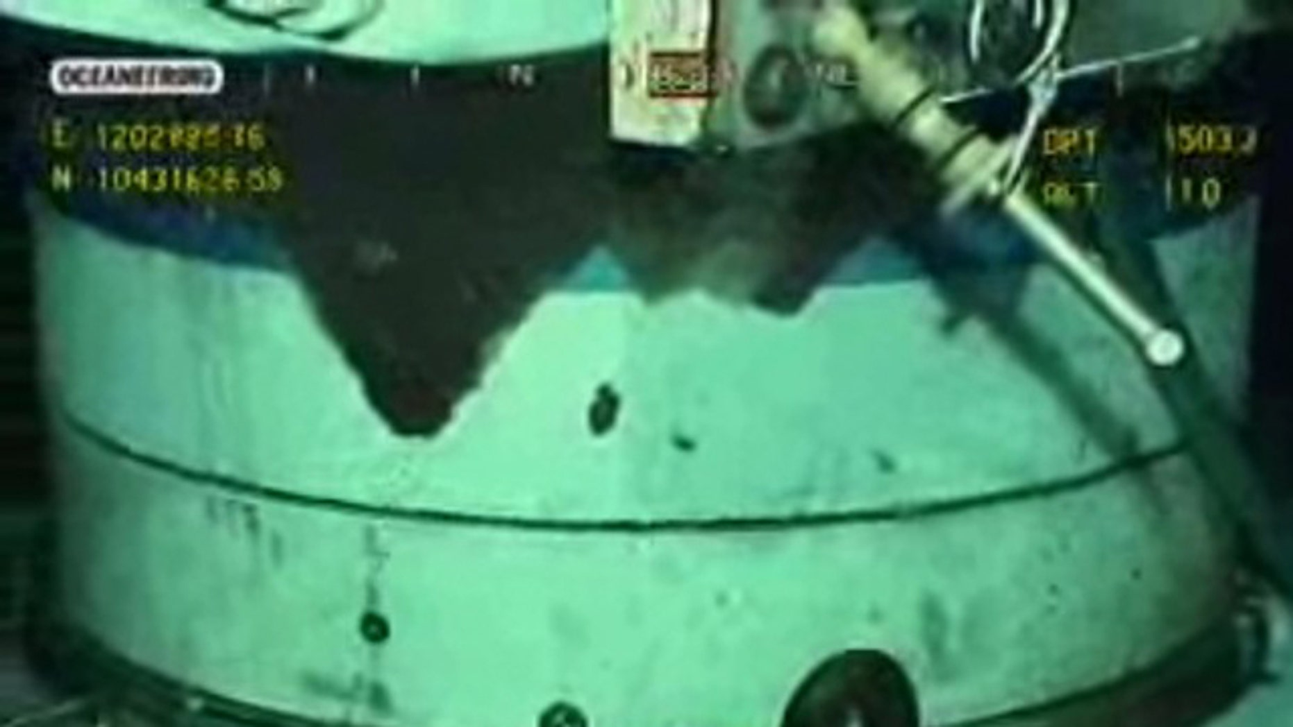 July 24: Bubbles rise from the new containment capping stack in this image captured from a BP live video feed from the Gulf of Mexico.