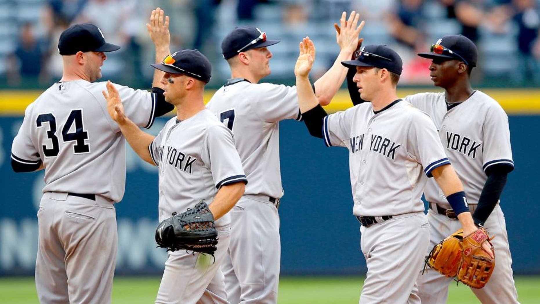 ATLANTA, GA - AUGUST 30: The New York Yankees celebrate their 20-6 win over the Atlanta Braves at Turner Field on August 30, 2015 in Atlanta, Georgia. (Photo by Kevin C. Cox/Getty Images)