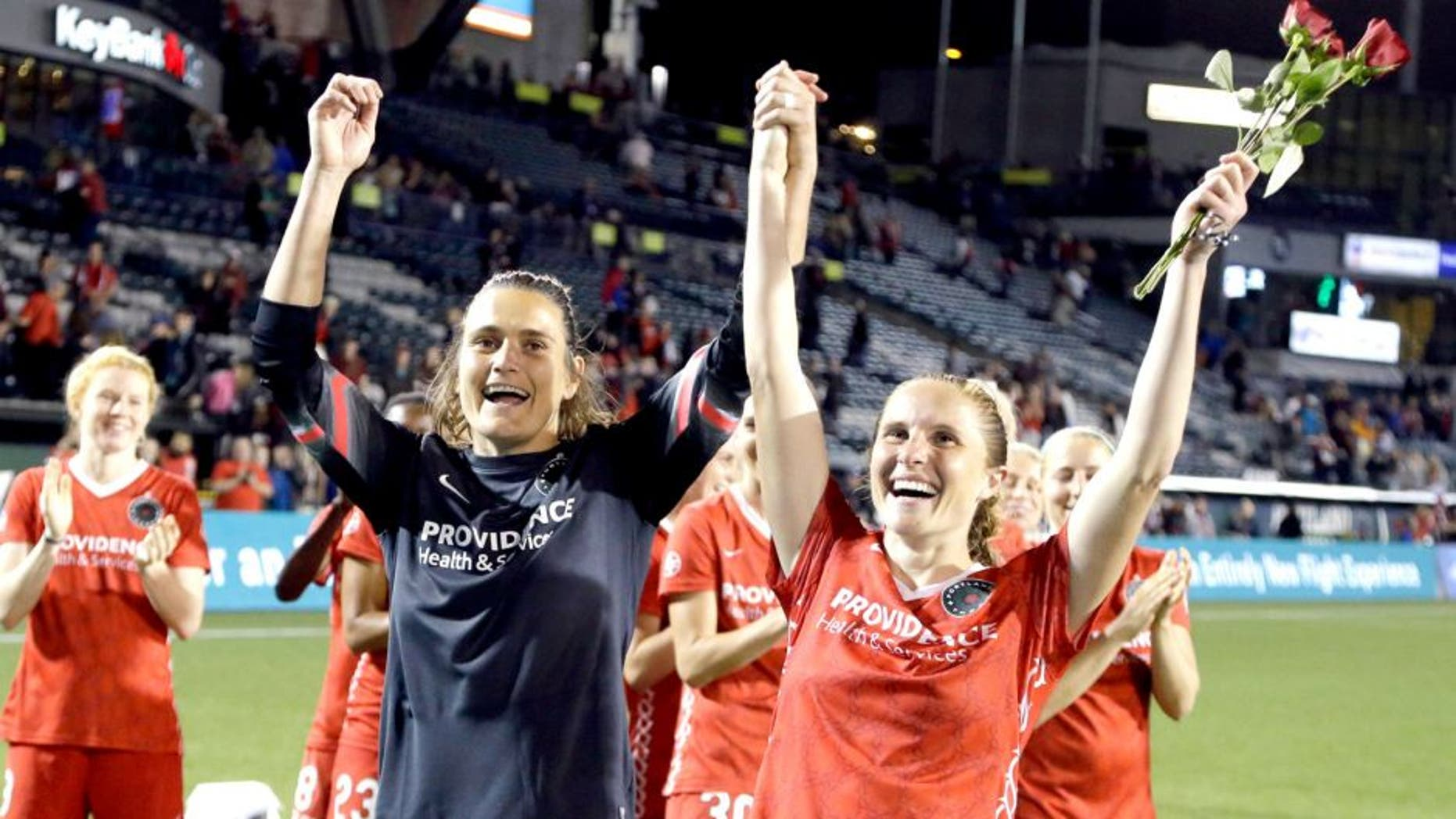 Portland Thorns goalkeeper Nadine Angerer, left, and defender Rachel Van Hollebeke celebrate after an NWSL soccer match against the Washington Spirit in Portland, Ore., Sunday, Aug. 30, 2015. Both players have announced their retirement from soccer. The teams tied 3-3. (AP Photo/Don Ryan)